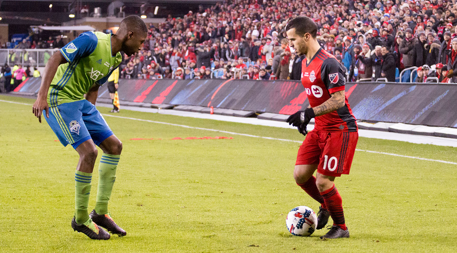 Sebastian Giovinco tries to get past another Seattle Sounder defender at BMO FIeld in 2017.Image by Dennis Marciniak of denMAR Media.