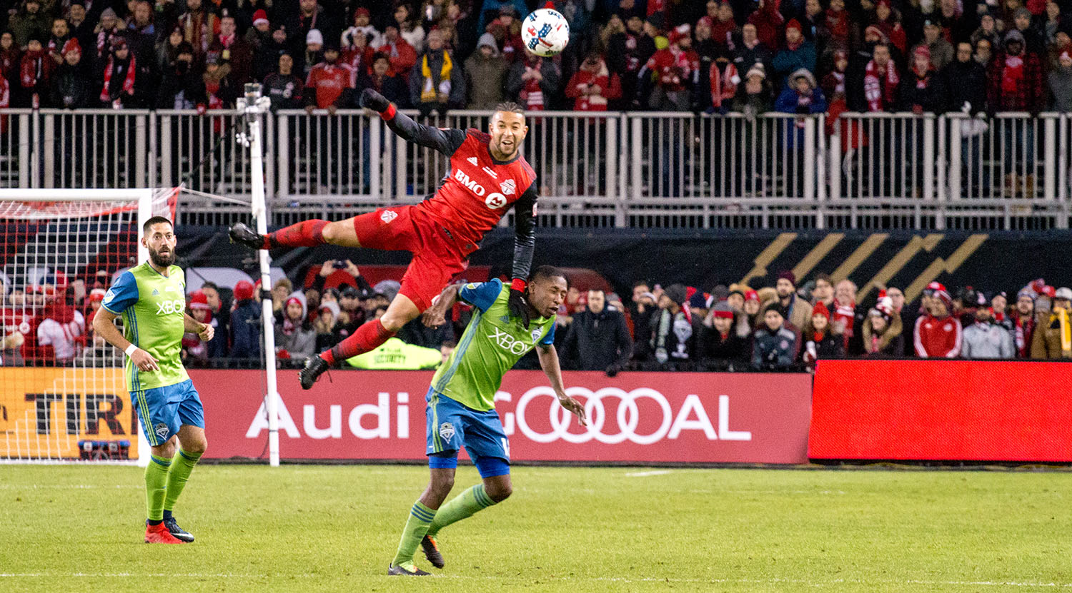 Justin Morrow takes flight during the 2017 MLS Cup Final to get a header to the ball at BMO FIeld.Image by Dennis Marciniak of denMAR Media.