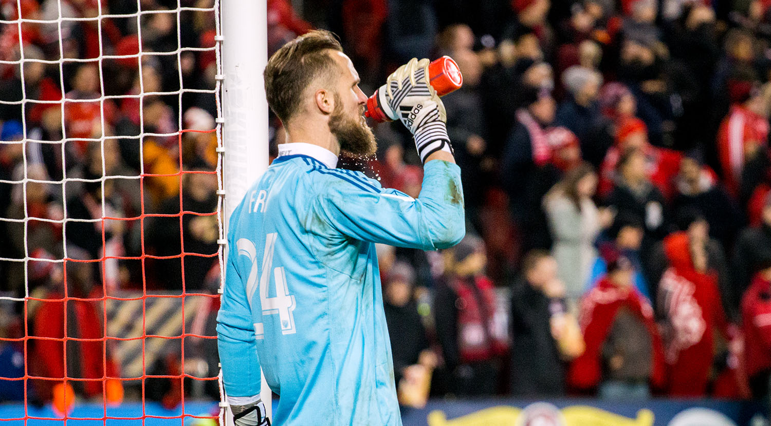Stefan Frei takes a sip of water as it trickles through his beard during the 2017 MLS Cup playoffs at BMO Field.Image by Dennis Marciniak of denMAR Media.