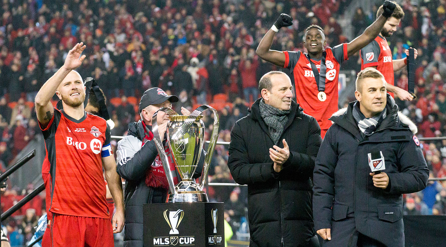 Michael Bradley, Don Garber and Taylor Twellman await the trophy presentation after the 2017 MLS Cup final whistle is blown.Image by Dennis Marciniak of denMAR Media.