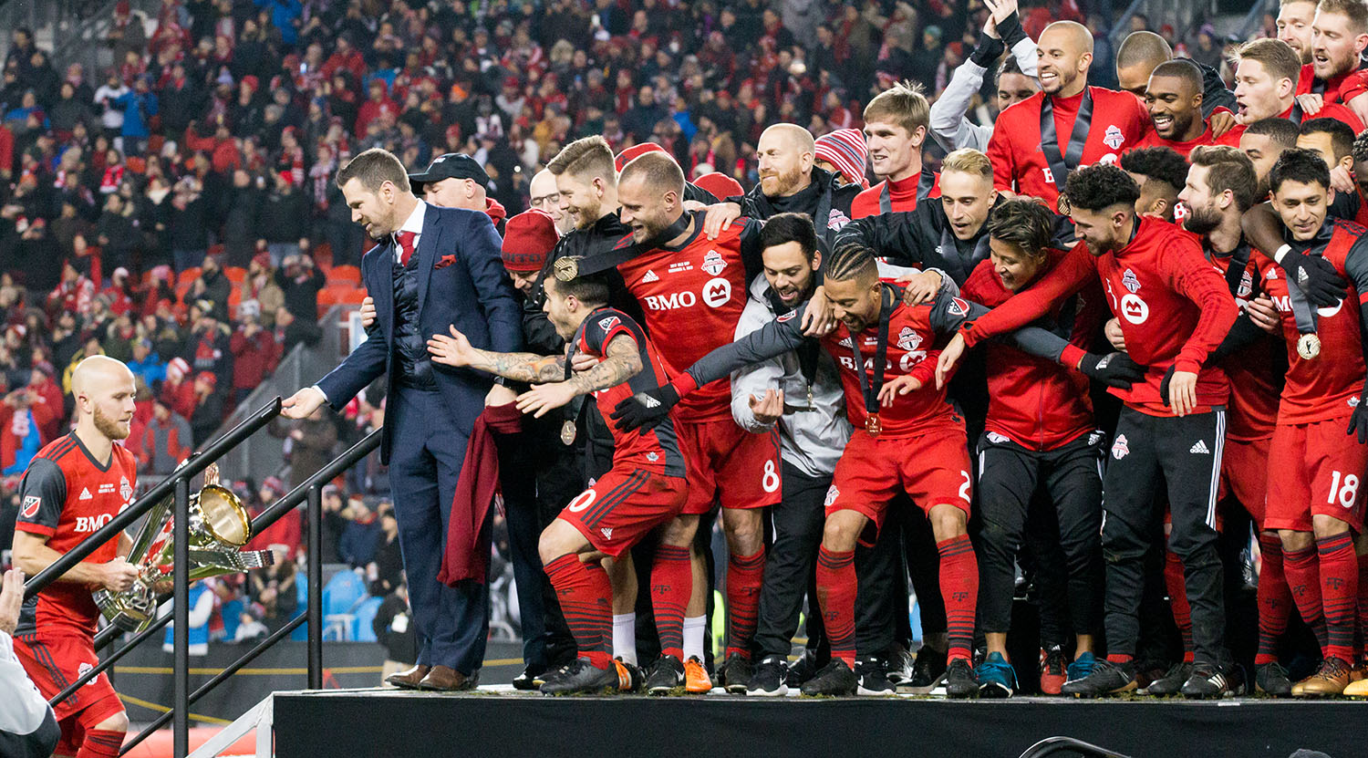 Michael Bradley taking the 2017 MLS Cup to the stage awaited by an excited Toronto FC.Image by Dennis Marciniak of denMAR Media.
