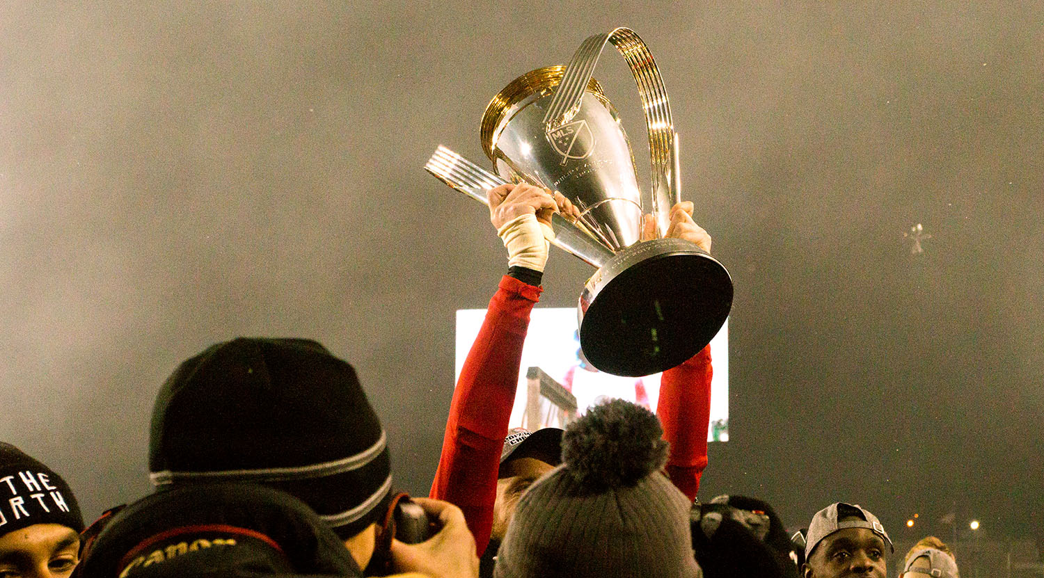 The trophy is lifted in the south end to celebrate the win for Toronto FC's 2017 MLS Cup win.Image by Dennis Marciniak of denMAR Media.
