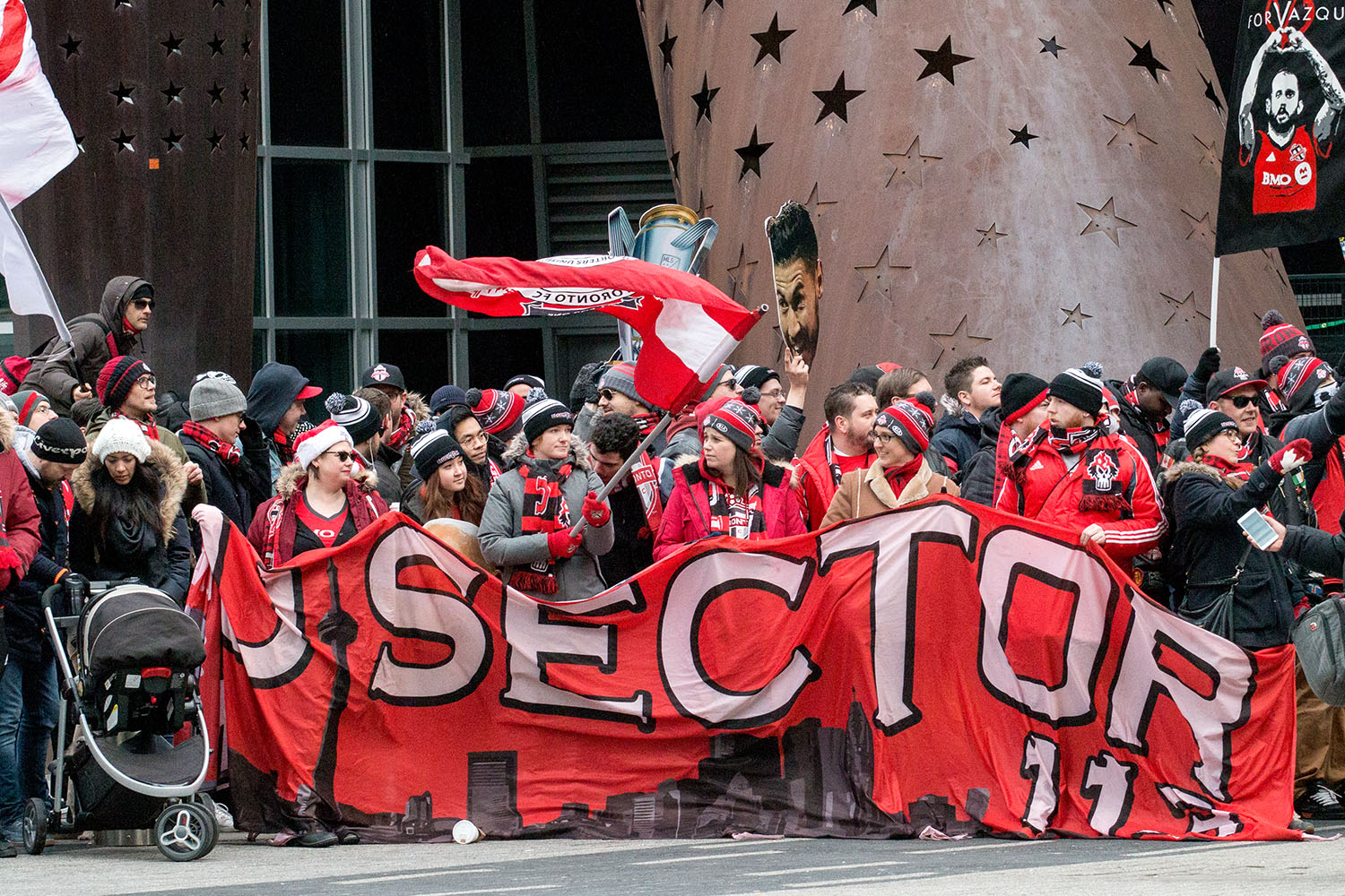 U-Sector showing their support in from the of the Air Canada Center for the Toronto FC 2017 MLS Cup Parade. Image by Dennis Marciniak of Denmar Media.