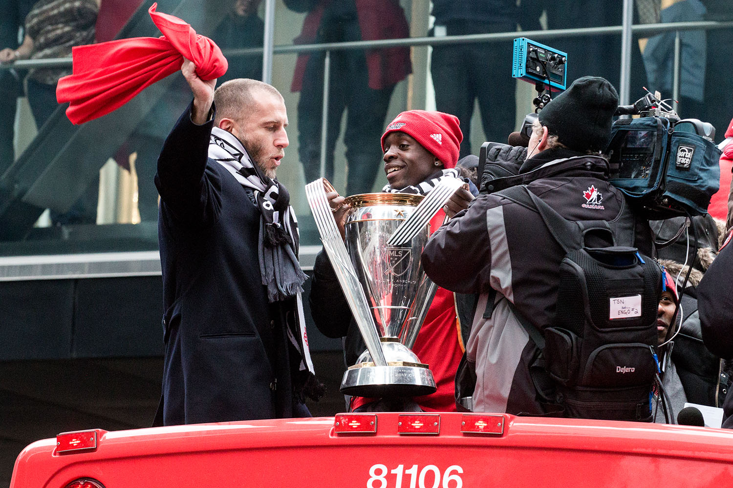 Toronto FC players celebrate with the trophy during the Toronto FC 2017 MLS Cup Parade. Image by Dennis Marciniak of Denmar Media.