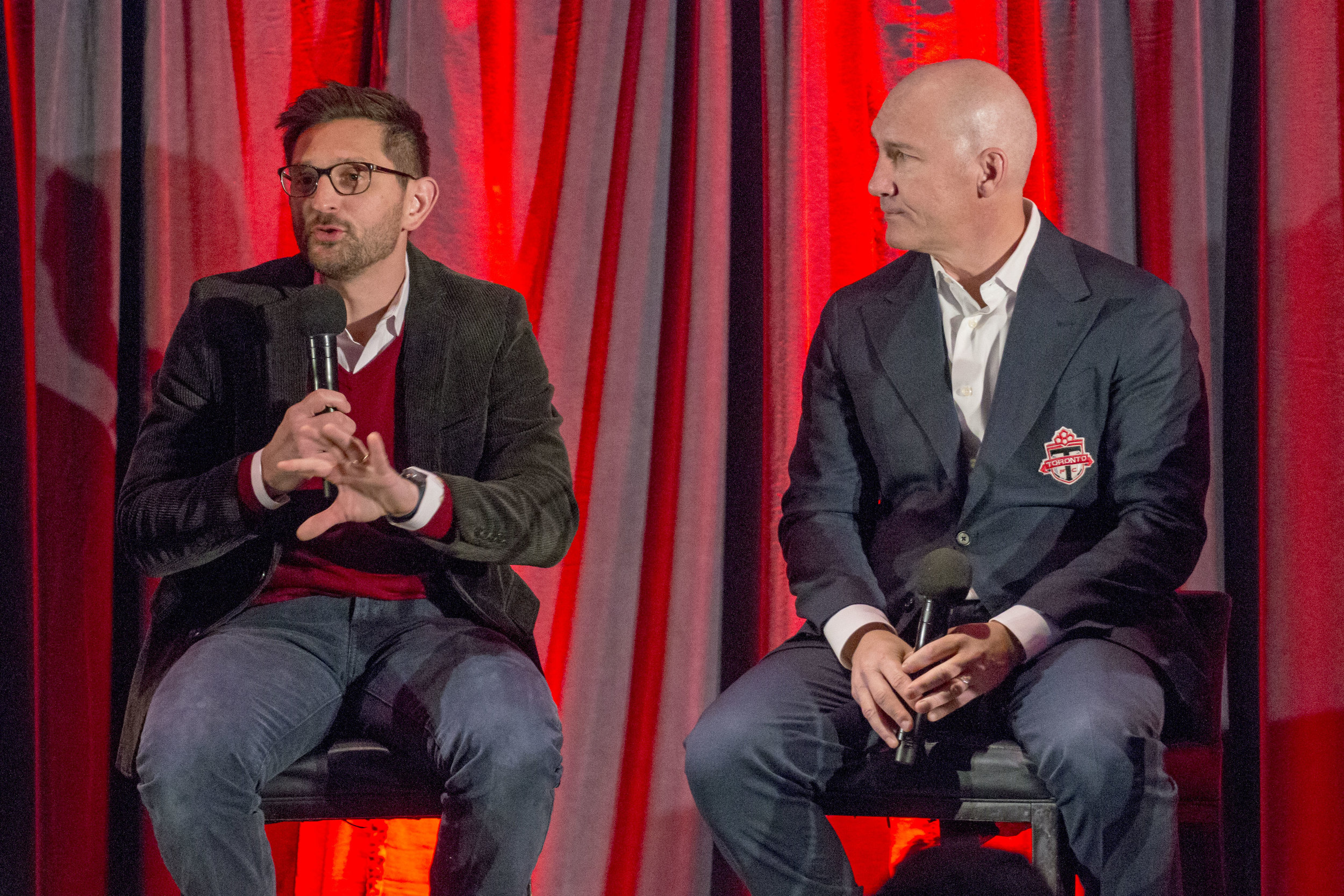 Tim Bezbatchenko and Bill Manning talk to season season holders at the Real Sports Bar and Grill in downtown Toronto, Canada. Image by Dennis Marciniak of denMAR Media.