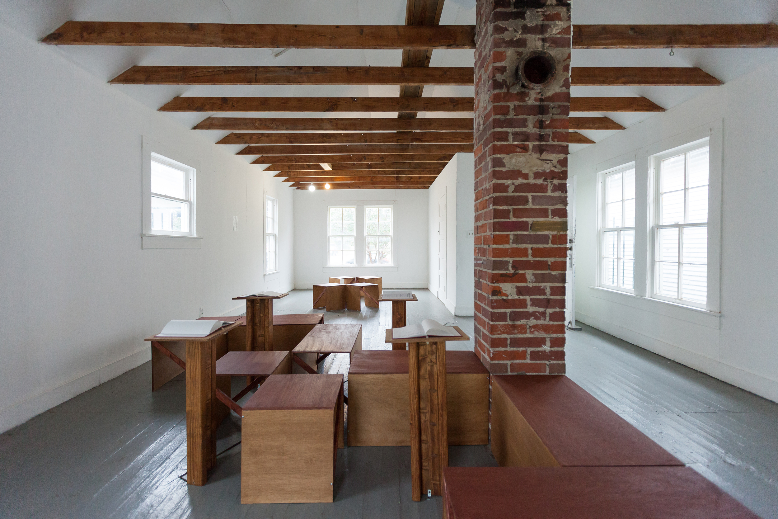 2015   In collaboration with Robert Anthony Weston Sr.   Hand built wooden benches and podiums, limited edition books of experimental text and poetry.  Project Row Houses.  photo credits: Alex Barber