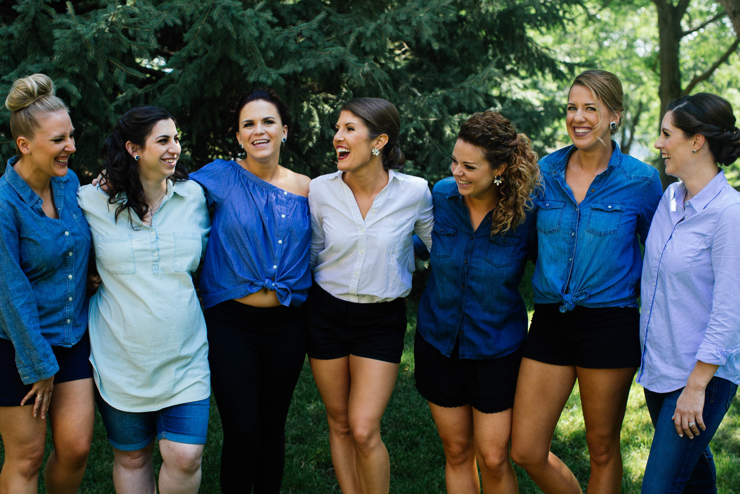 Bridesmaids wearing denim blue button downs