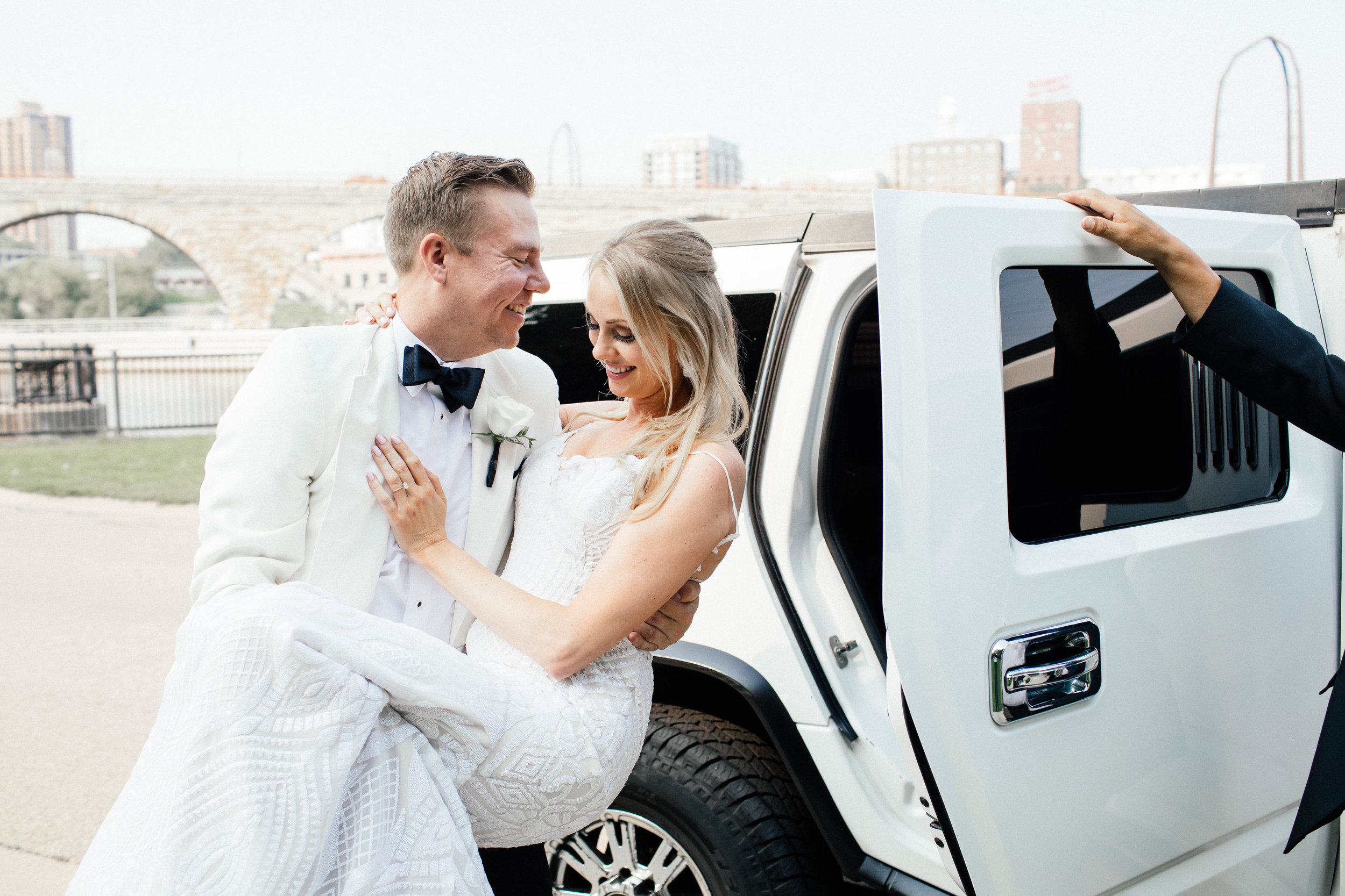 Hewing Hotel Wedding Photography groom helping bride into limo
