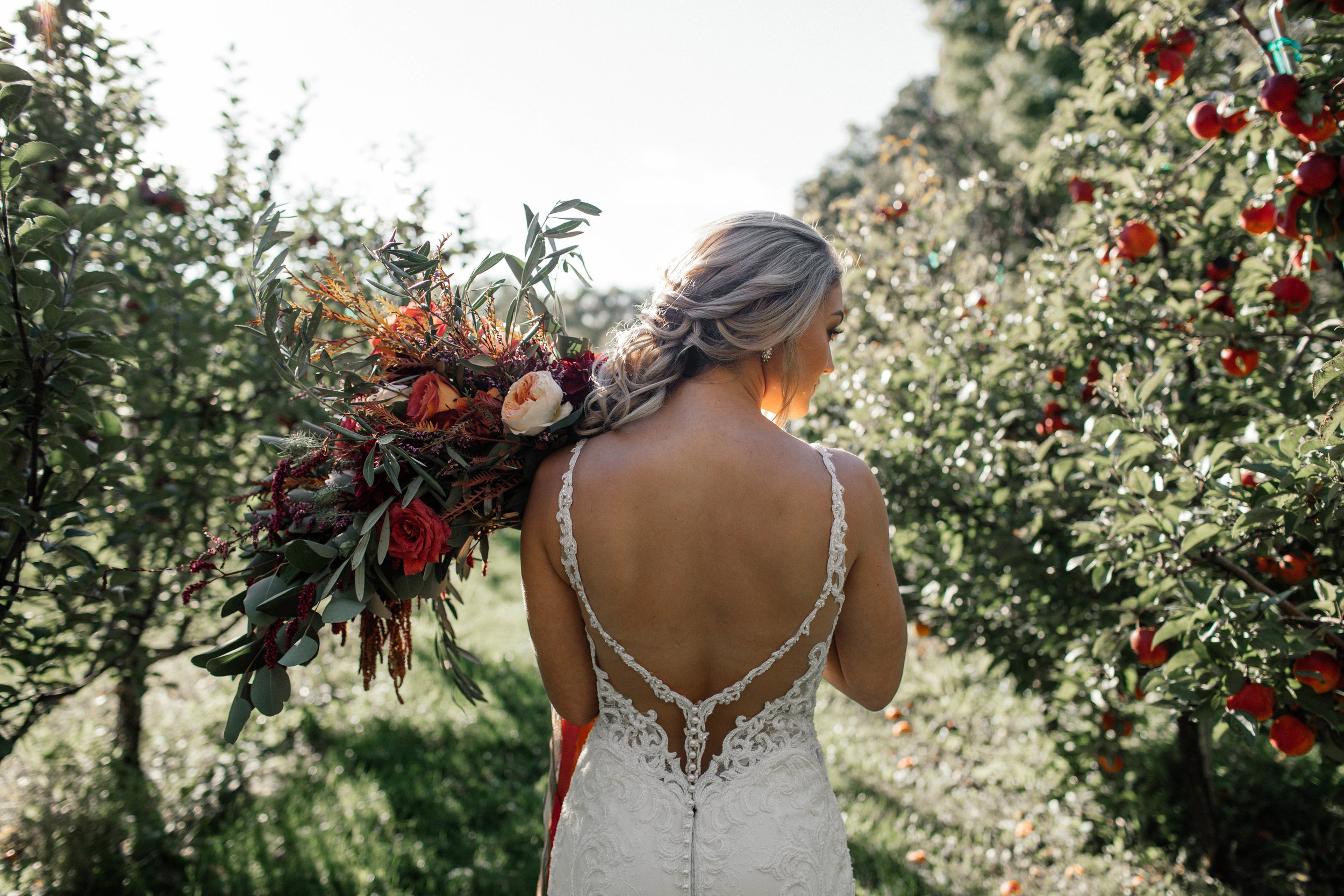 Bridal Accents Couture Wedding Gown Bridal Portrait shot in an apple orchard