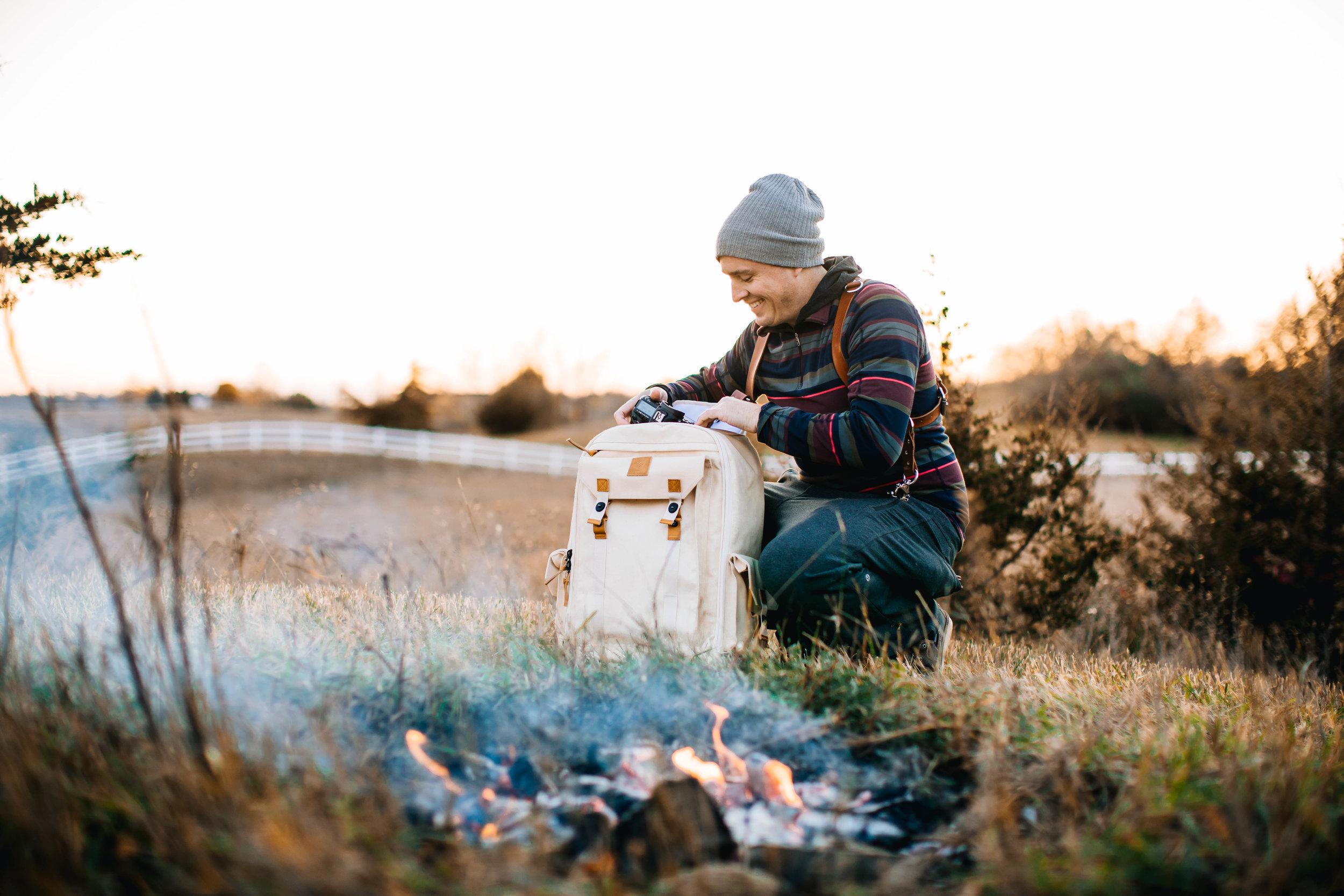 Minnesota Wedding Photographer with backpack