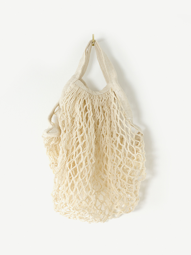 A cotton net bag for her Sunday trips to the Farmer's Market.