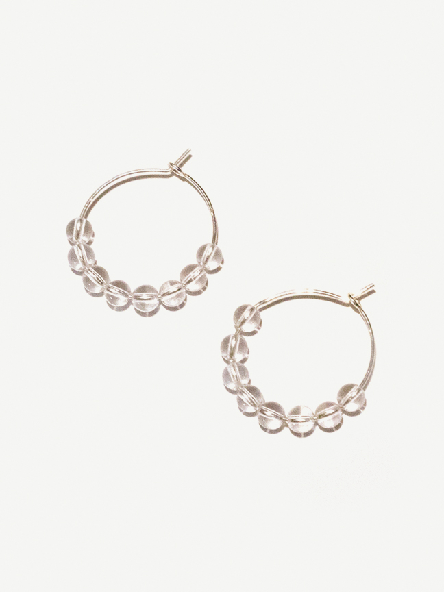 Unique hoop earrings with quartz, a crystal known for amplifying energy and intention.