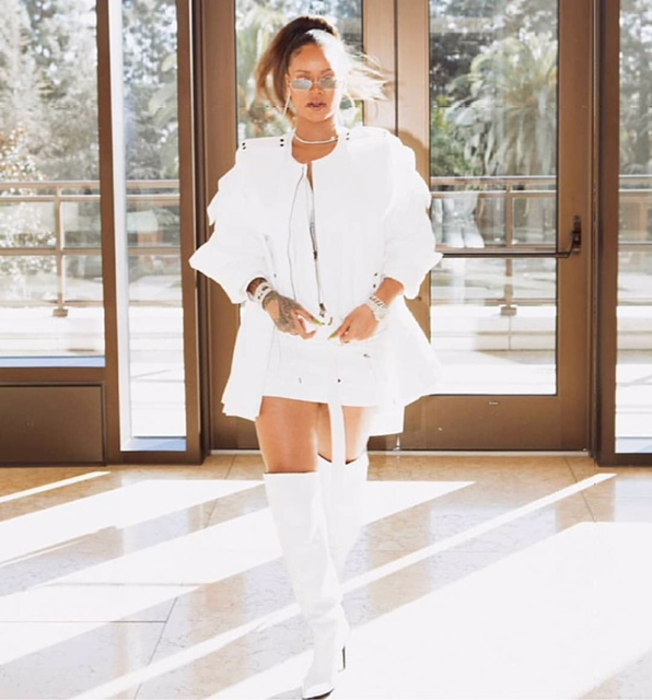 Before attending Jay-Z Holiday party, Riri performed TDEXMAS17 with Kendrick Lamar and wore this.  White Denim Jacket from Calvin Klein:  Top & Skirt: Tom Ford;  Boots:Off-White  Sunglasses:: Gentle Monster   Jewelry Chopard