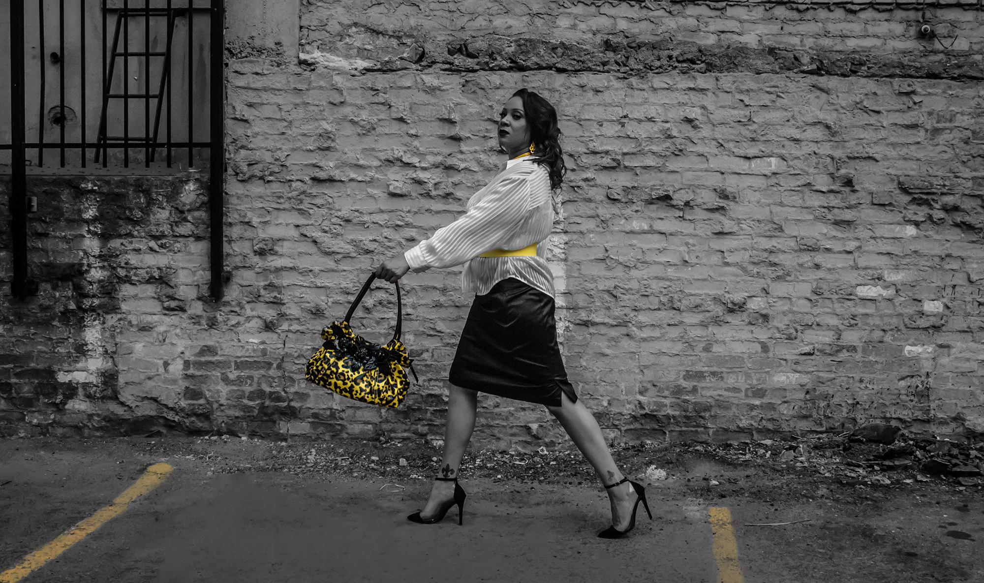Yellow for all seasons. Accessorize, accessorize, accessorize.   Faux yellow and black patent leather animal print handbag   Stylish 100% polyester sheer blouse   Black cotton blend A-line skirt with kick split   Lemon yellow 100% leather belt