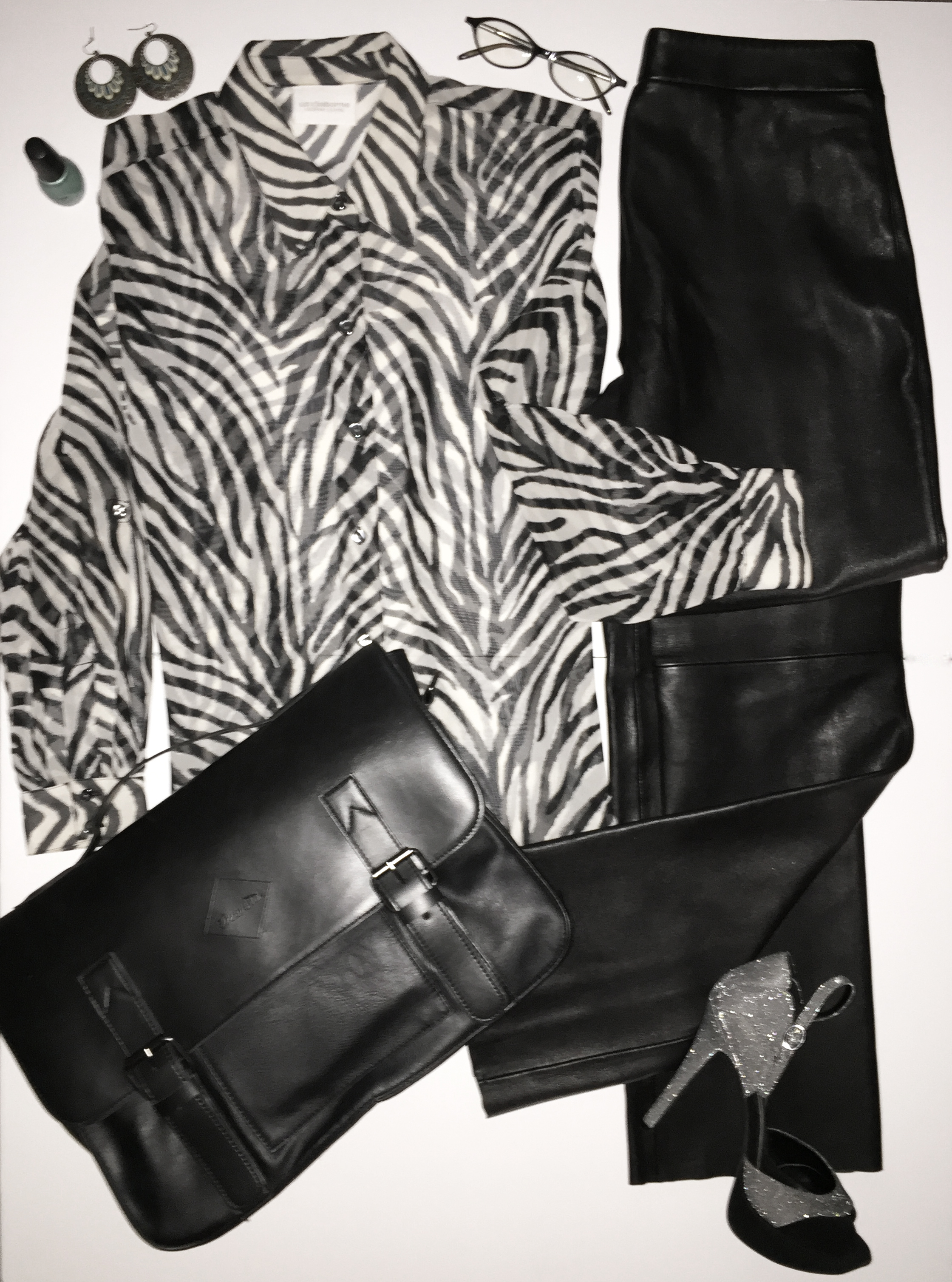 Sheer blouse, leather pants and glitter vintage inspired heels can take you from office to cocktails, in seconds.