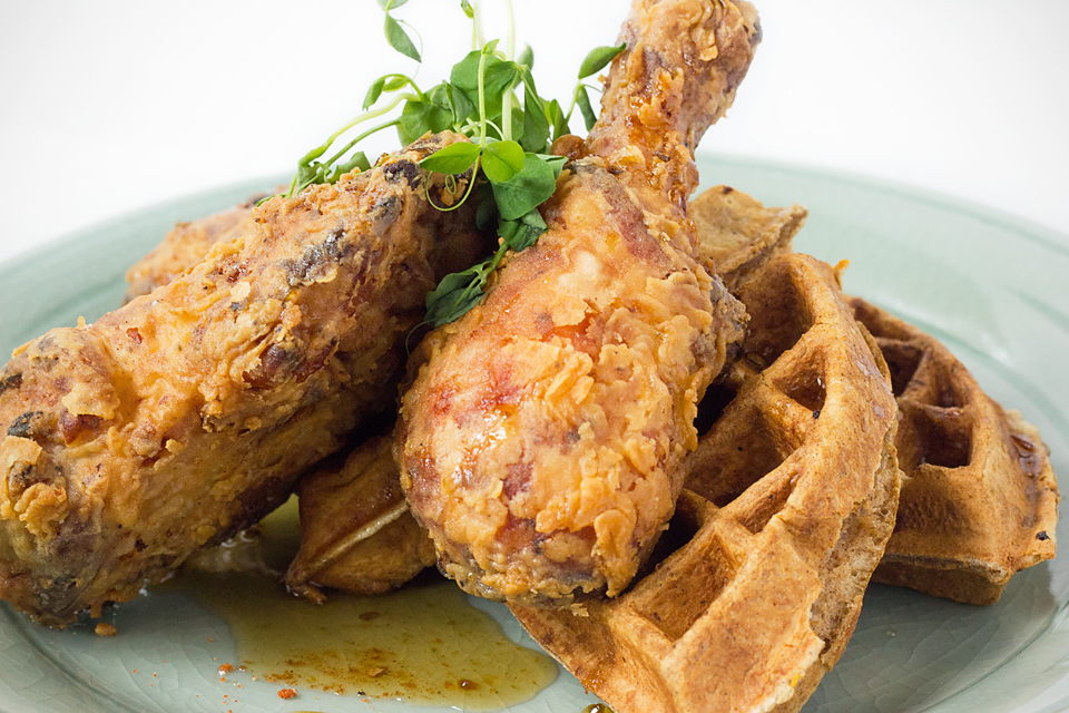 Chicken and WafflesTwice fried chicken breast and cheddar hushpuppy waffle with brown sugar butter, apple syrup and pickled apples -