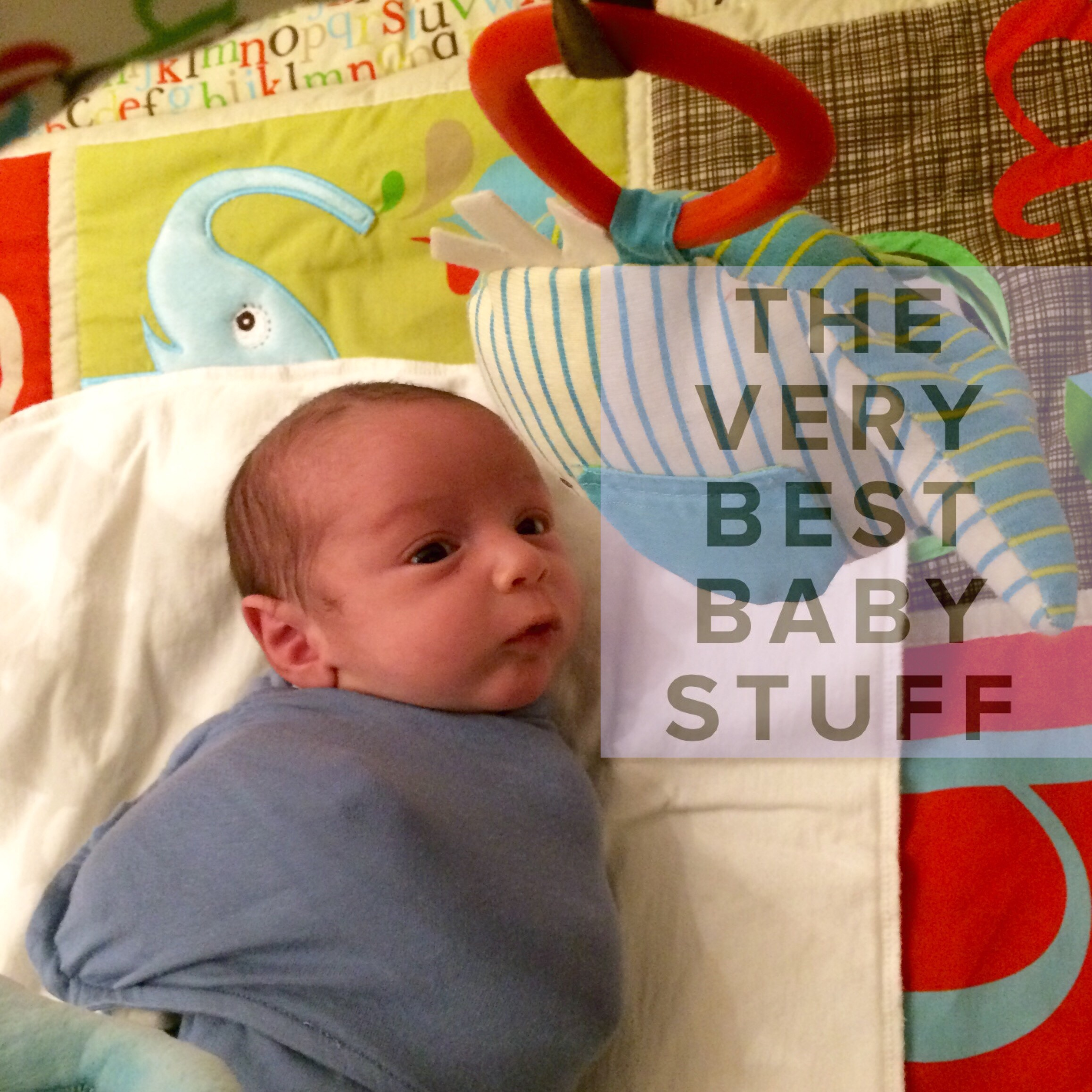 This is S's first time on the mat at 2 weeks. He was instantly captivated.