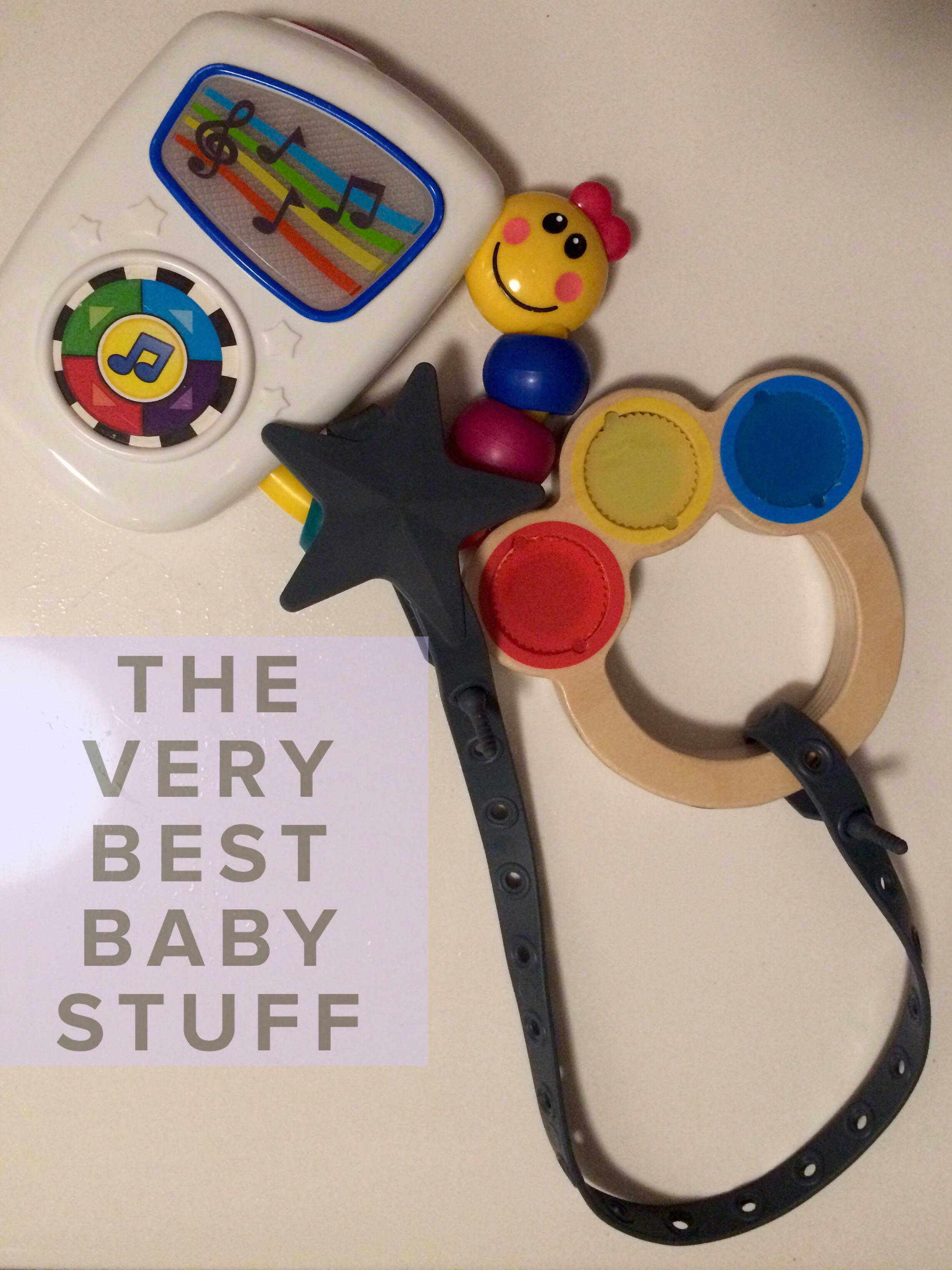 Baby Einstein Take Along Tunes  and a  Hape Mini Maraca  attached to  L'il Sidekick Leash .
