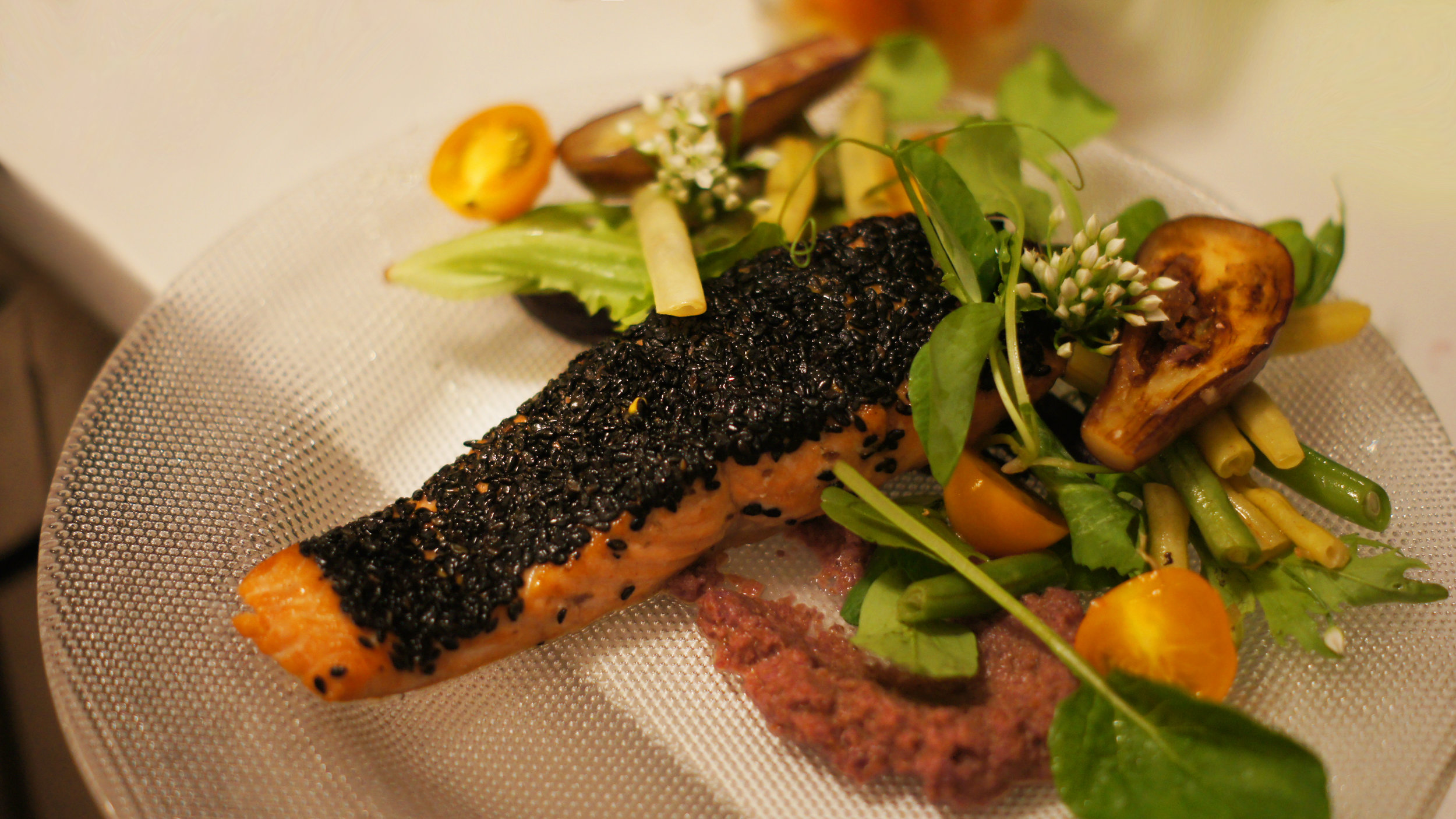 Wild salmon crusted in sesame seeds, carrot pure and grilled seasonal vegetables as the entree