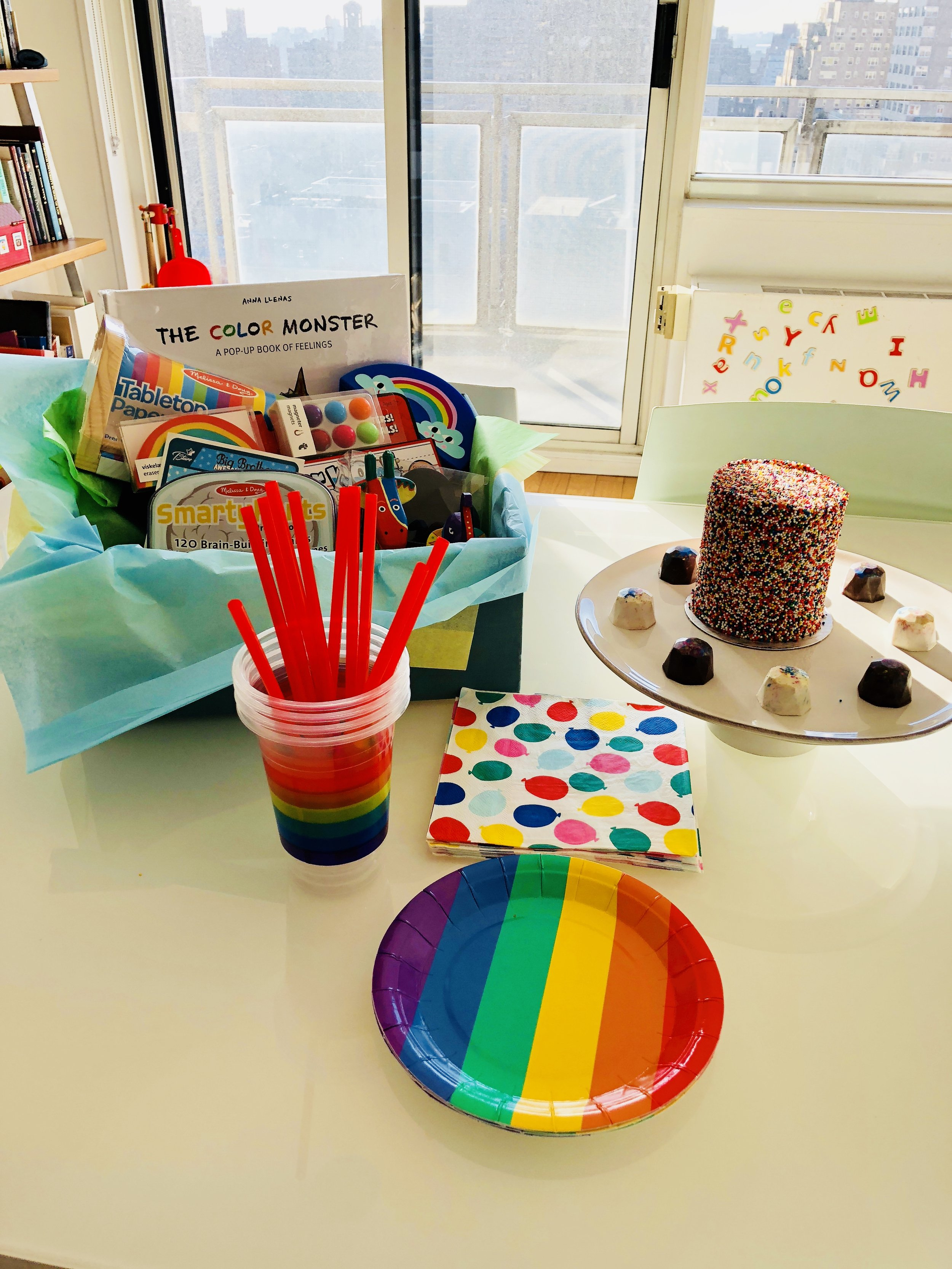 Rainbow cake and sibling gift basket