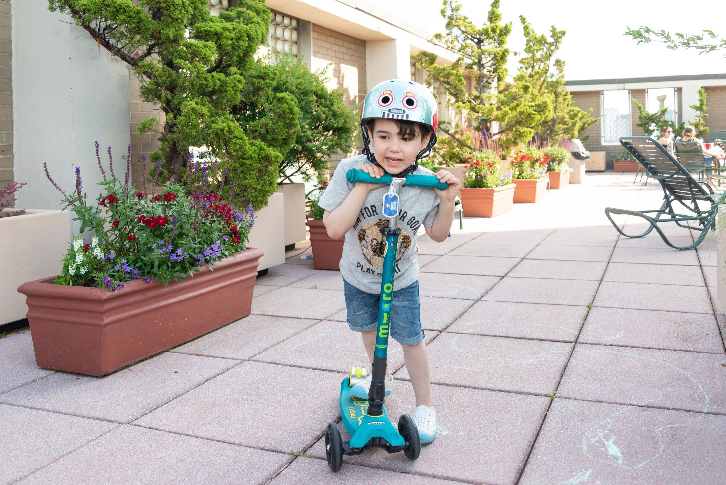 """Using a """" bag tag """" makes it easy to identify Sam's scooter."""