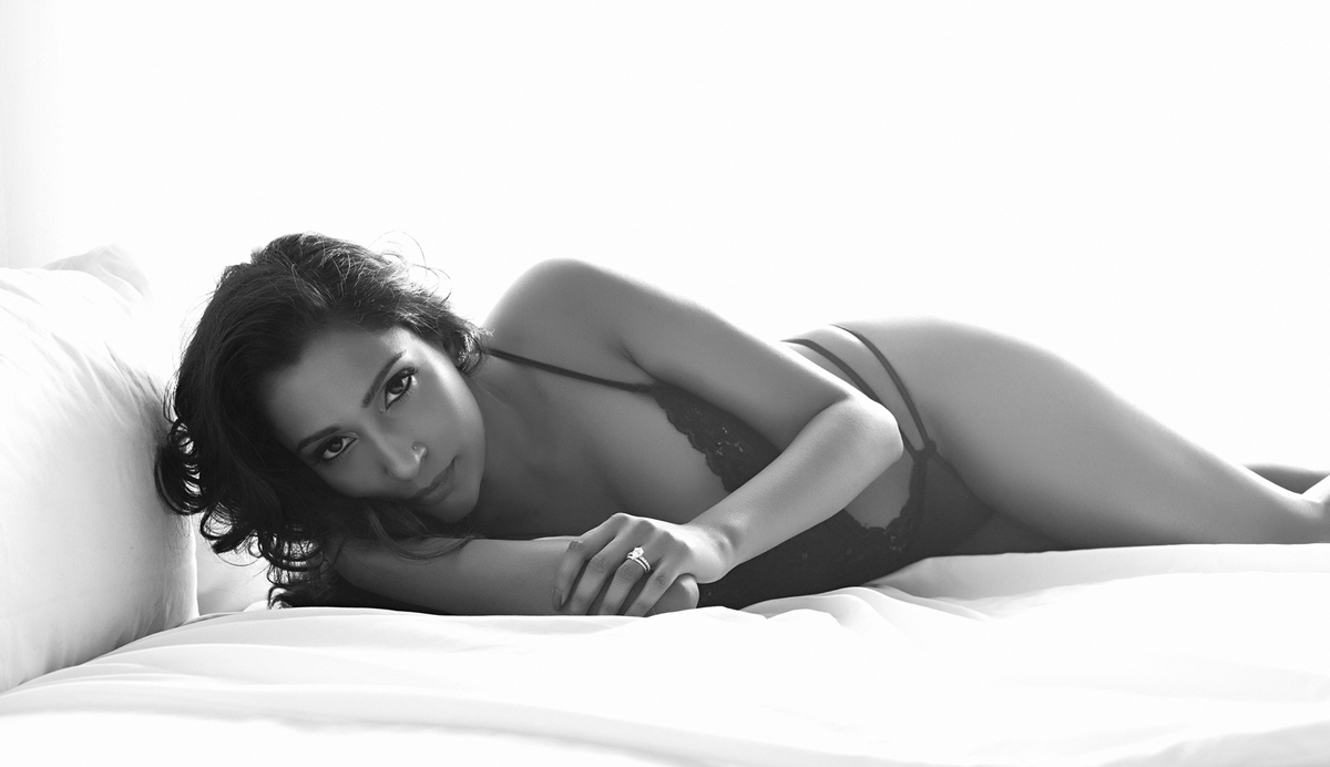 A soft expression and white sheets - all that's required for a great boudoir shot.