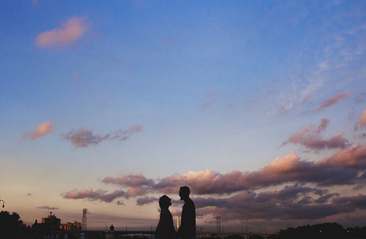 Emily + Chris marvel at each other (and this sunset) in this urban Toledo couples session.