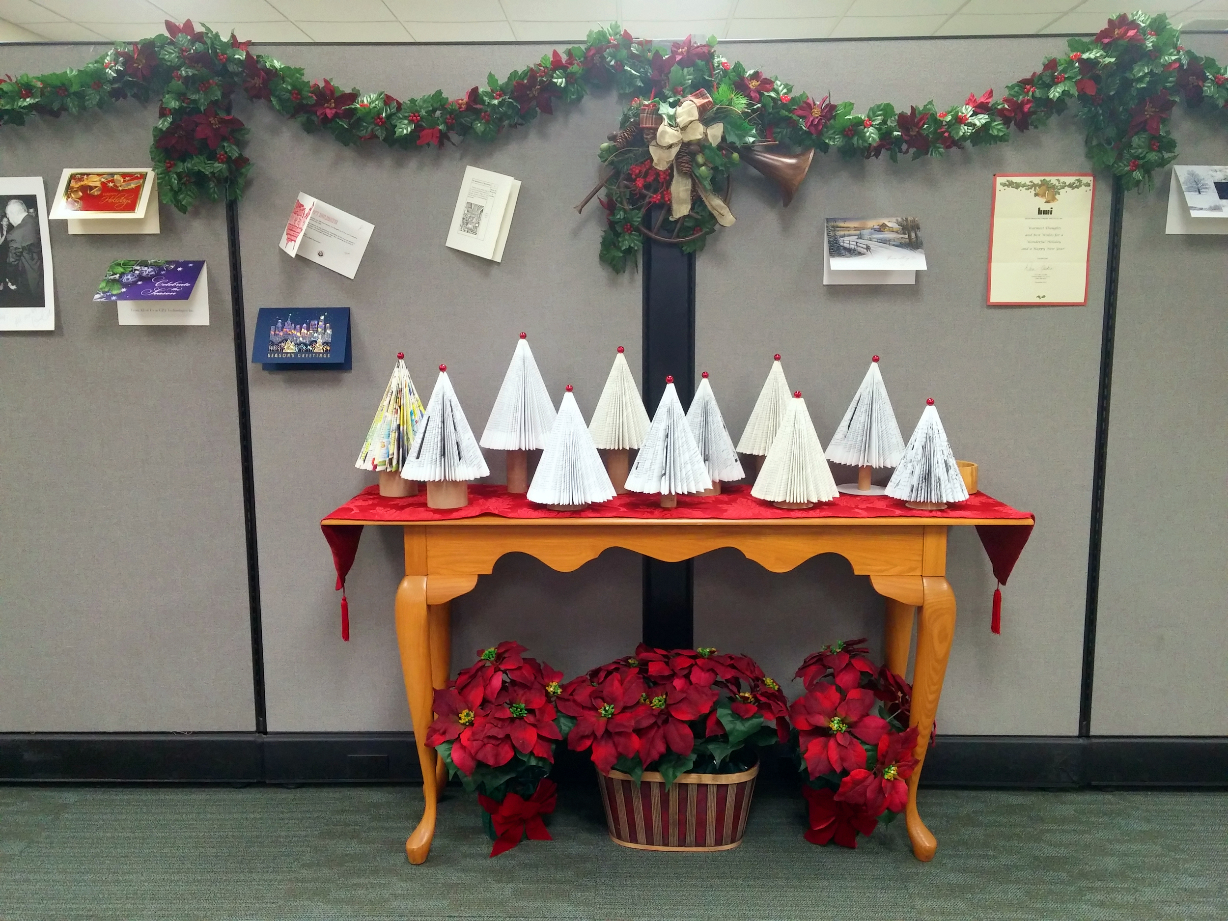 Mini folded book trees on display in our front office