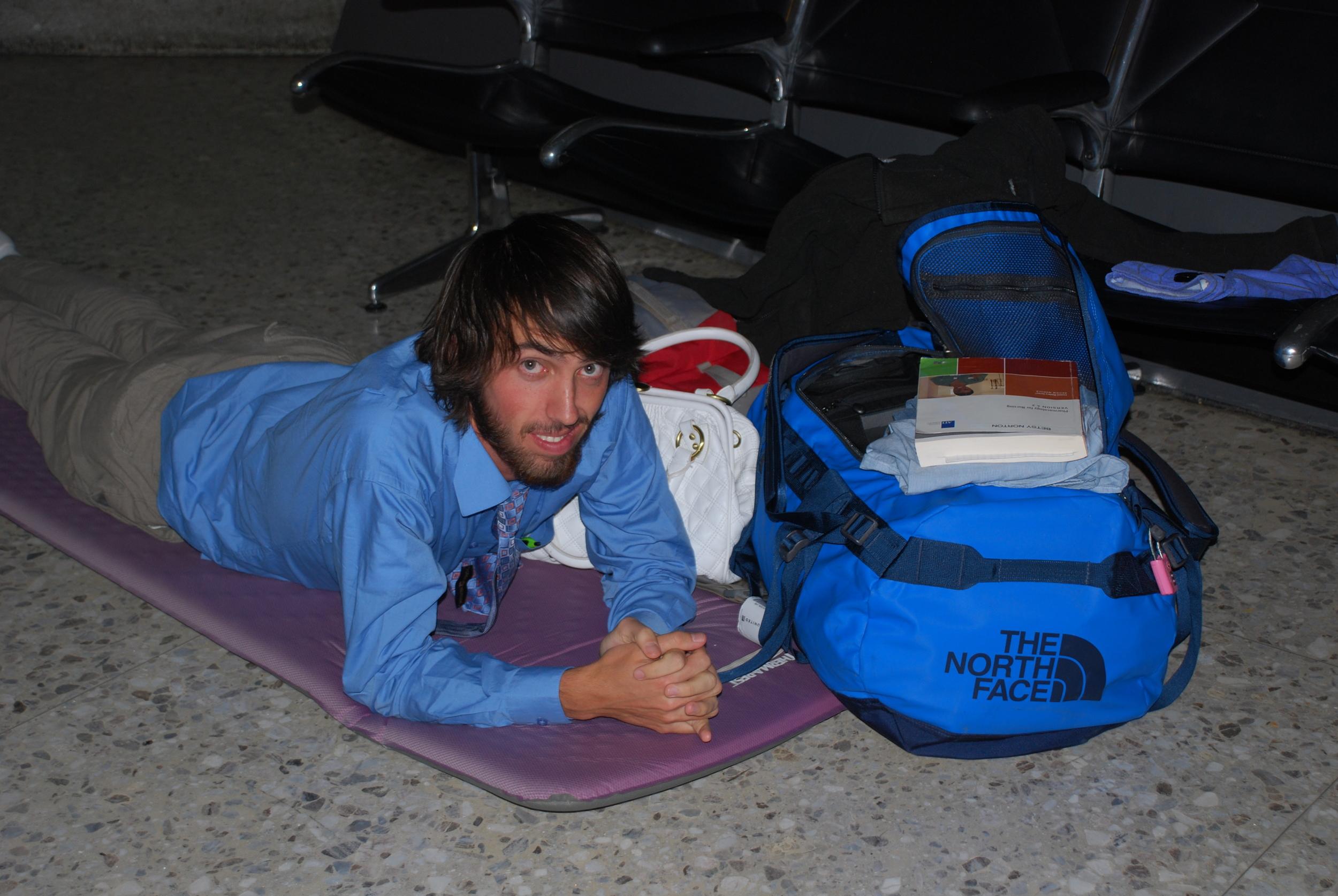 Sleeping on the floor of Dulles International Airport en-route to Africa