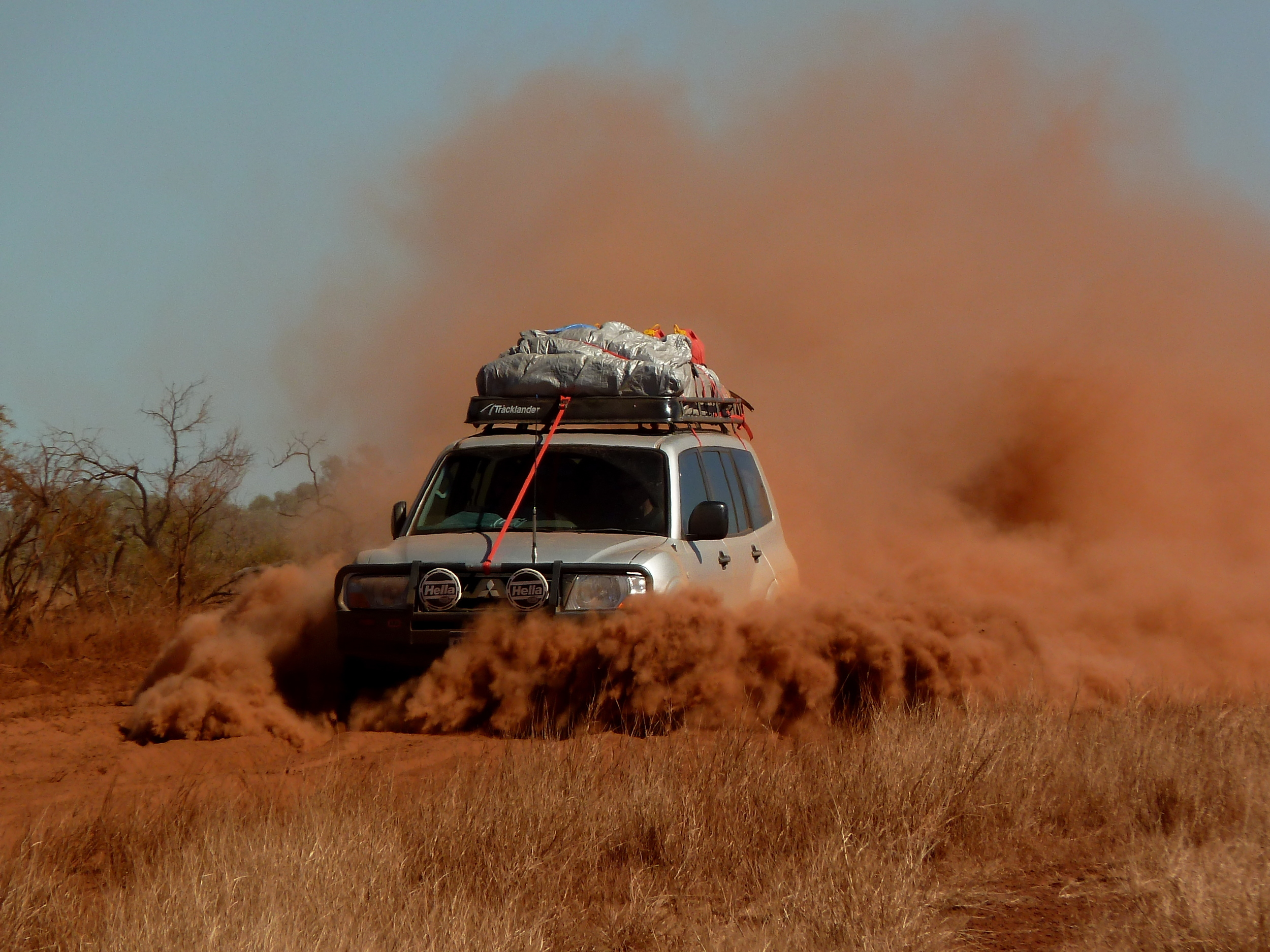 Parting shot... us driving through bull dust. Some of my things are still stained from that red dust! Photo credit: Gerzy