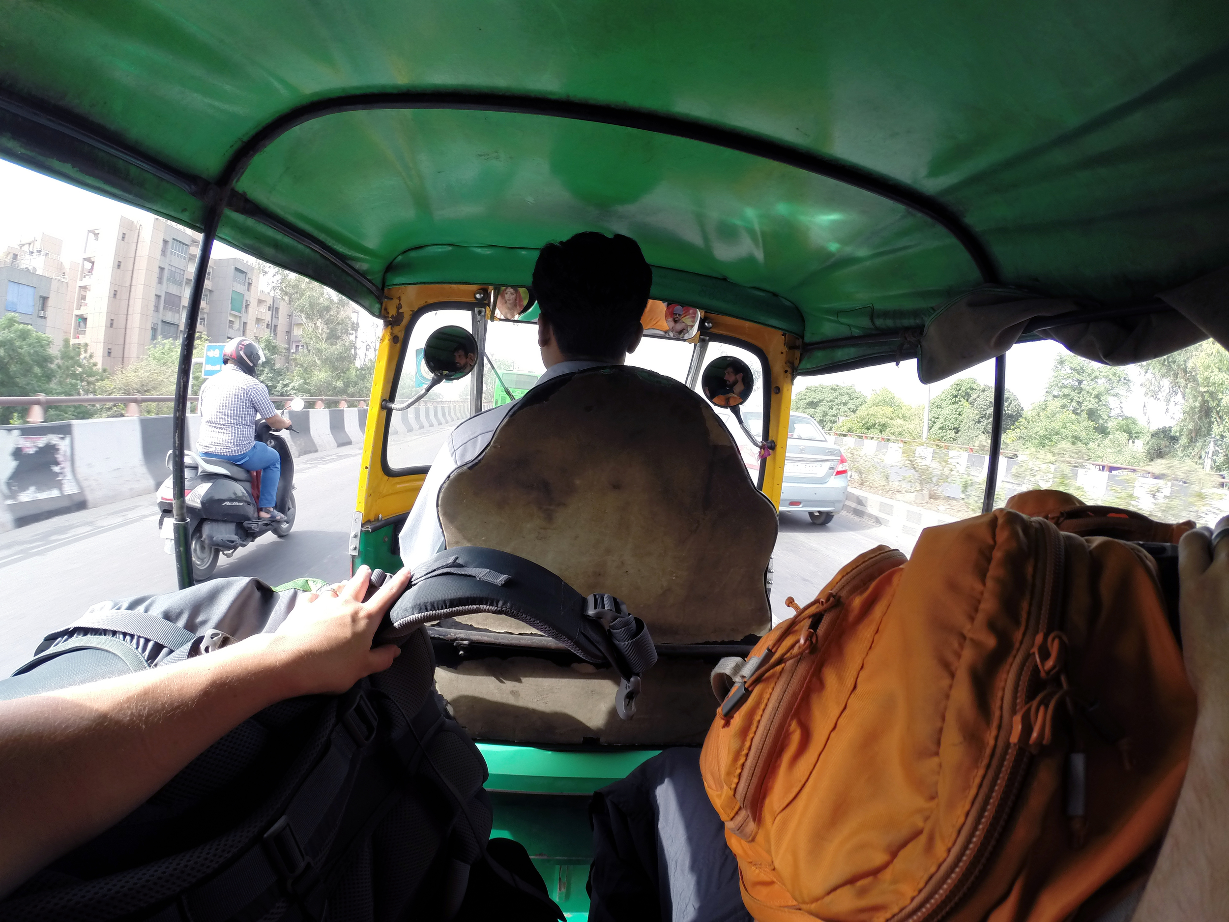 Taking a rickshaw across Delhi from the metro station to our hotel