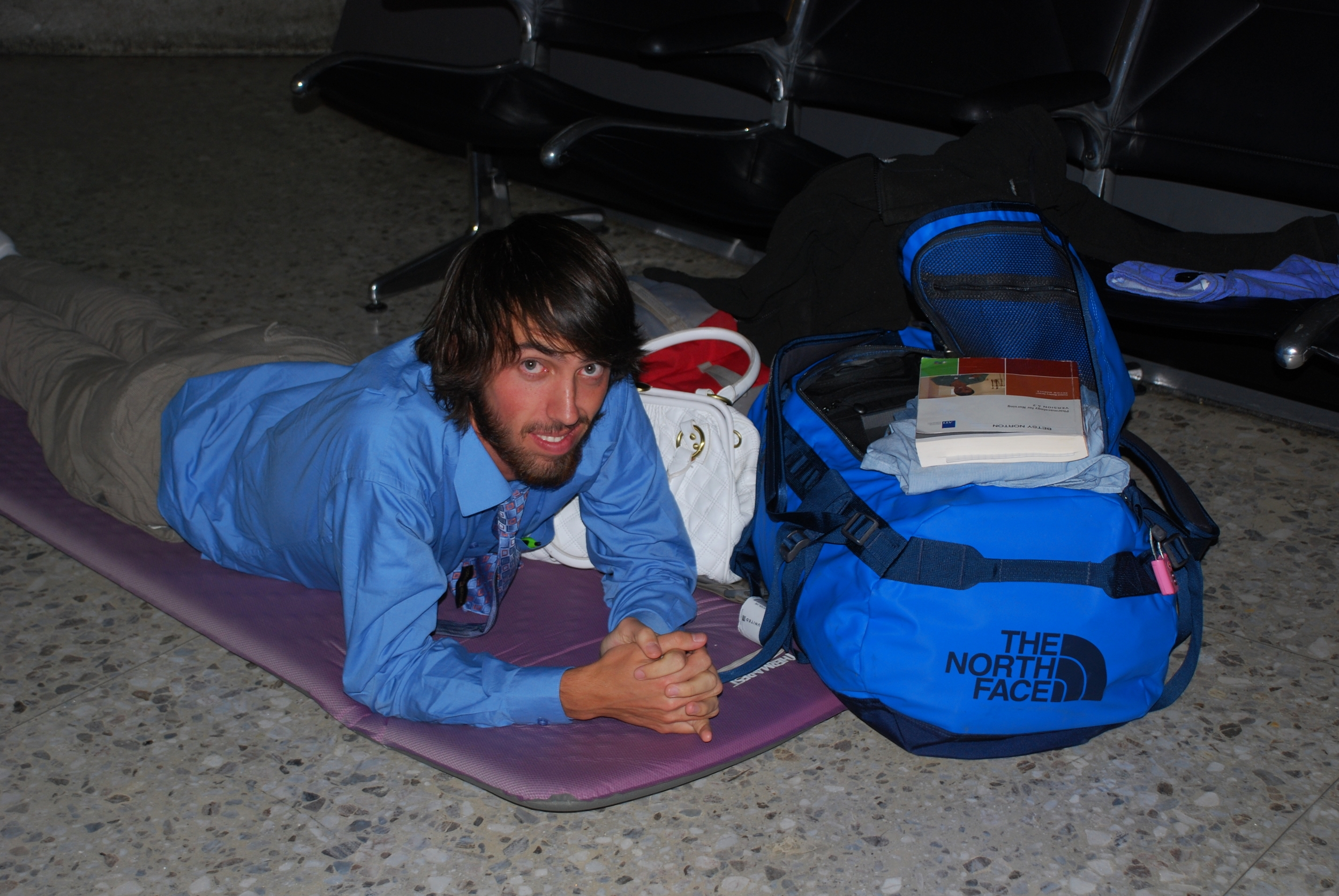 Sleeping on the floor in D.C. during a long layover on our way to Africa.