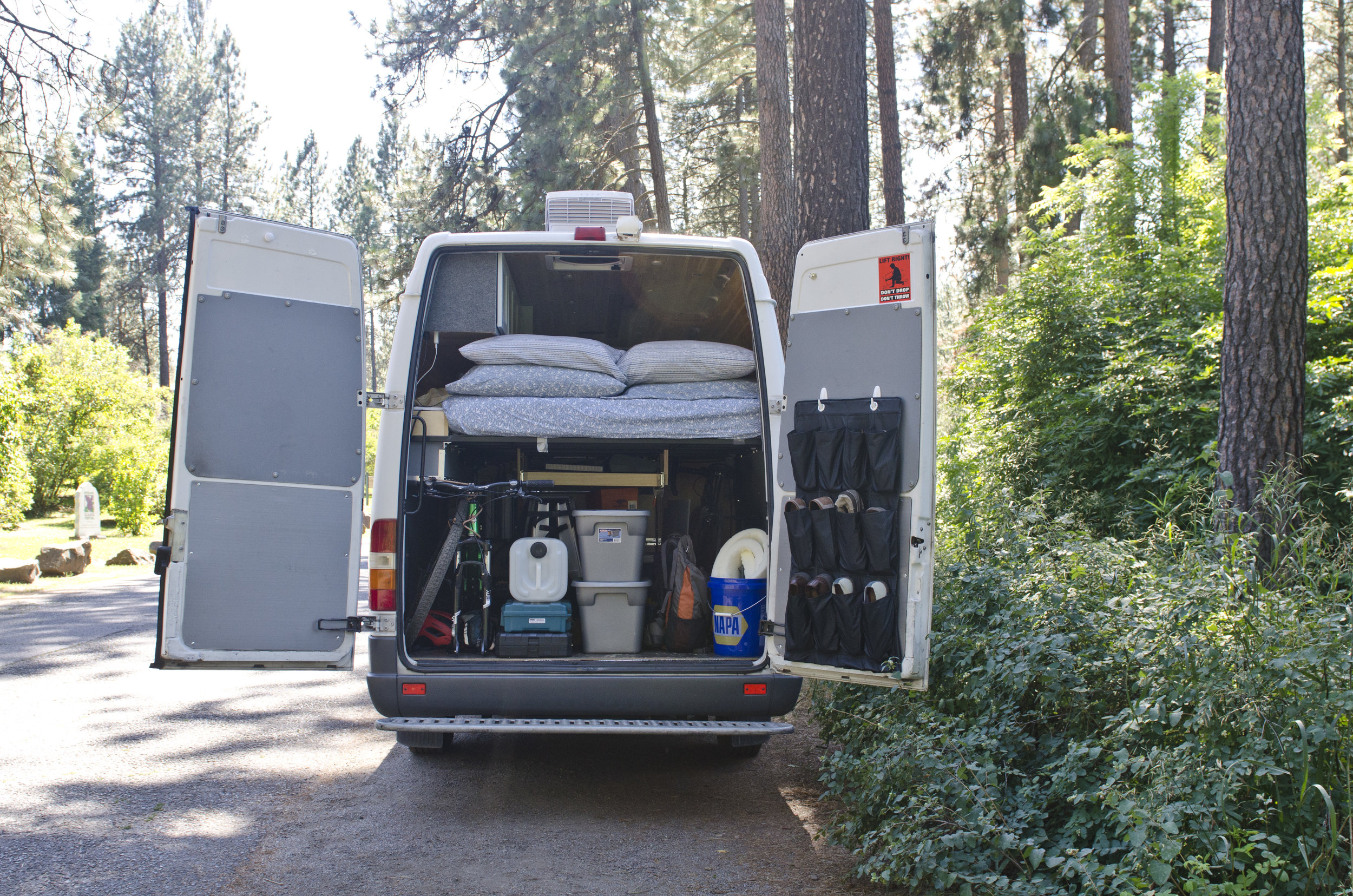 """Our """"garage"""" space under the bed, which holds two bikes, an Oru kayak, tools etc"""