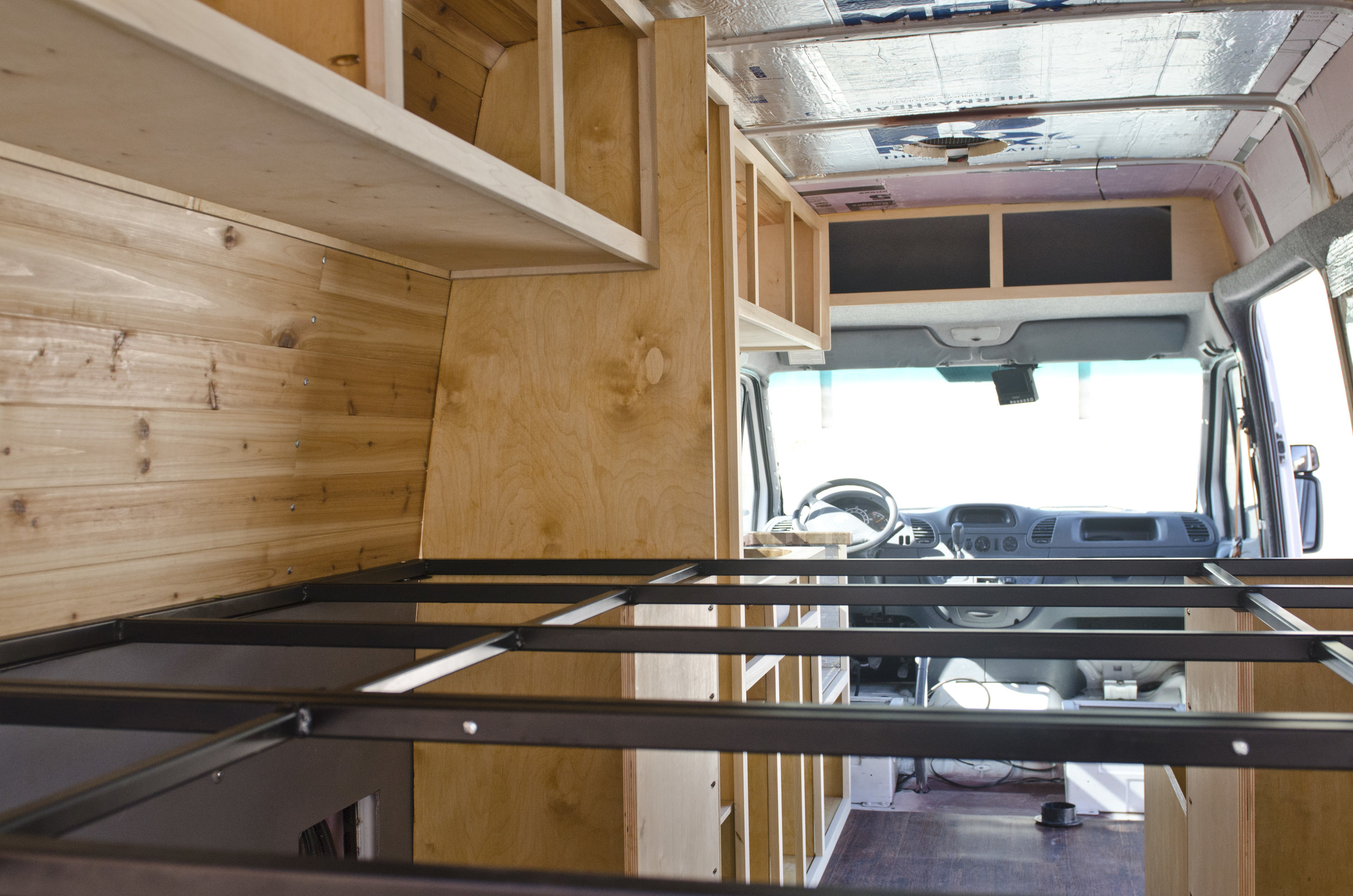 Cabinets framed out and bed frame welded and in place thanks to my amazing parents