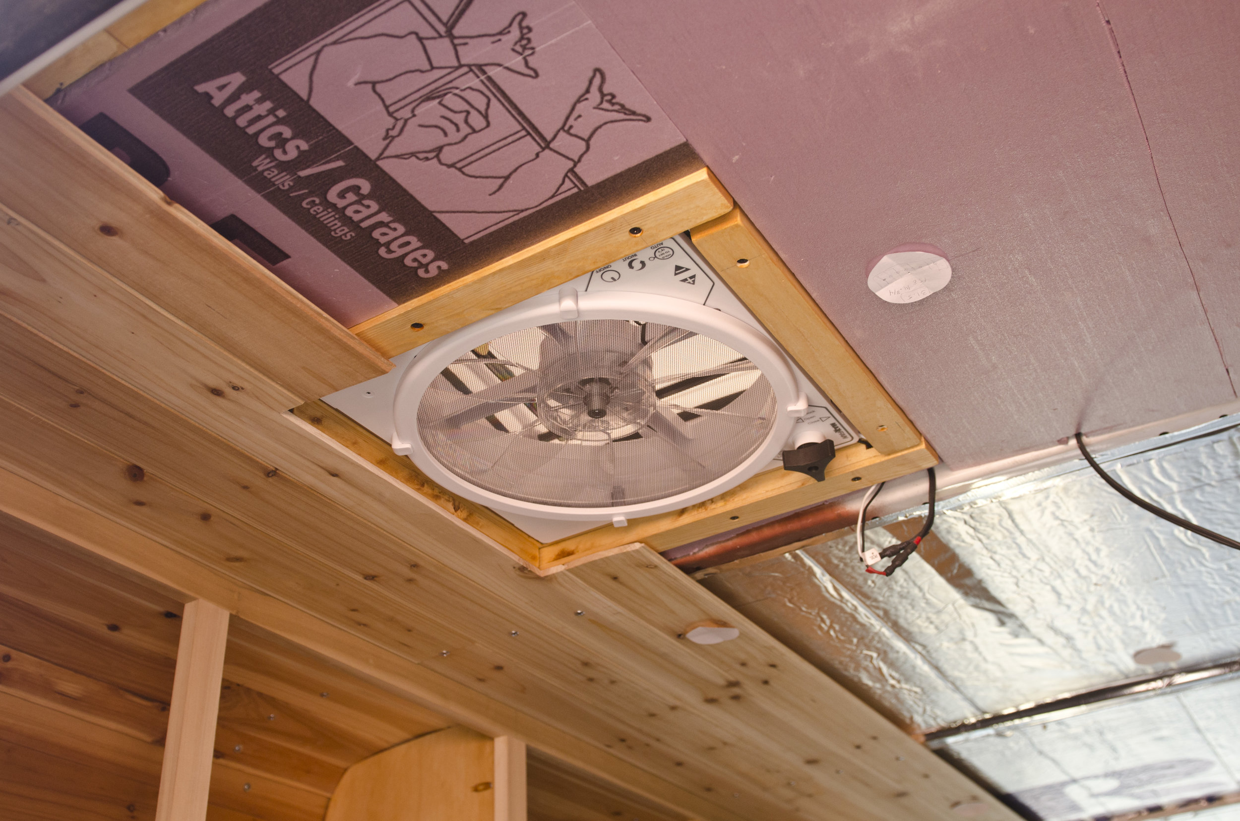 Installing our Maxx Fan over the bed + paneling the ceiling