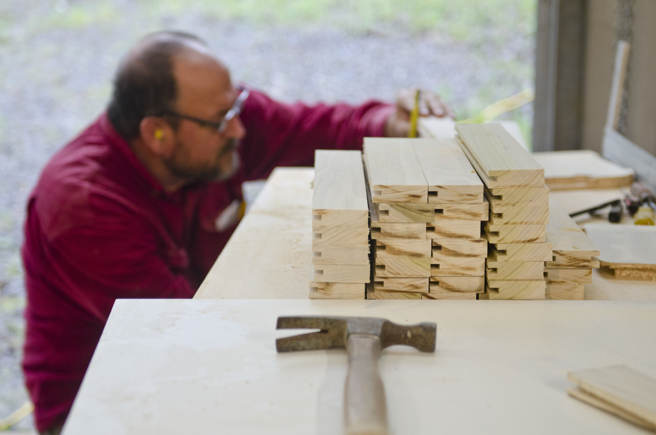Justin's dad working on our Shaker style cabinet doors