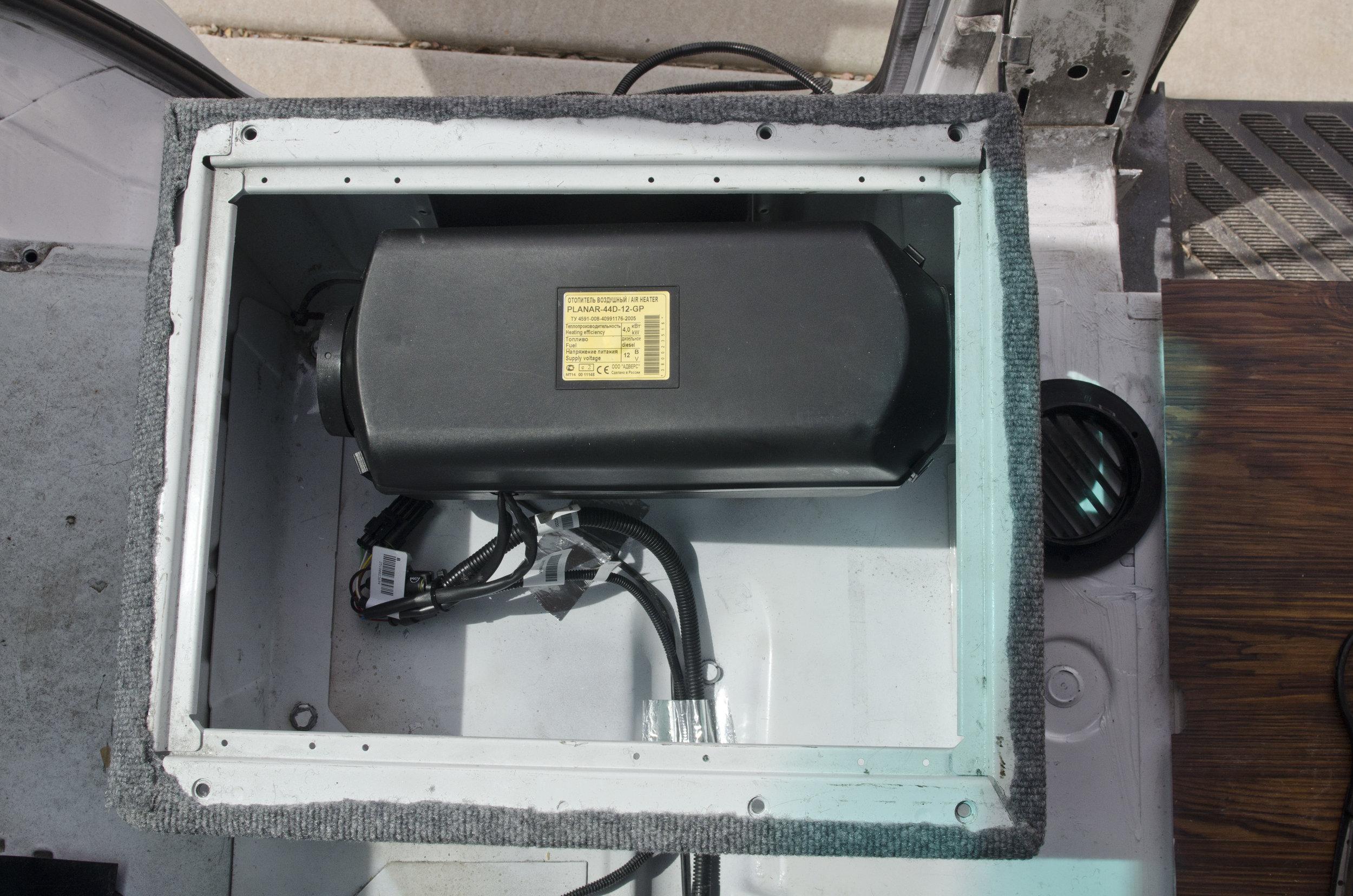 Installing our diesel heater under the passenger seat
