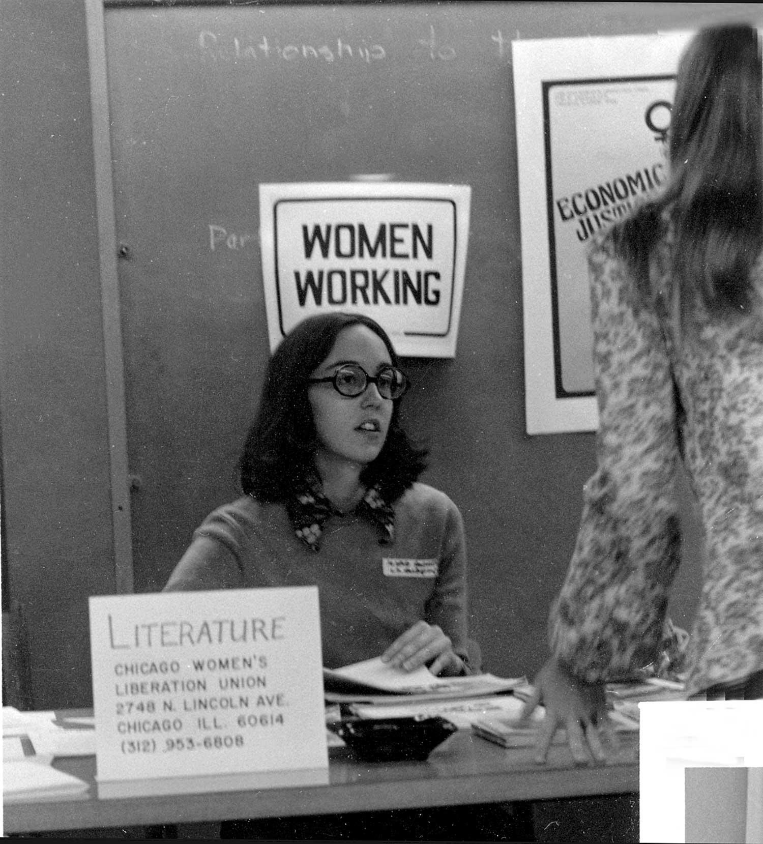 Margaret at CWLU info table