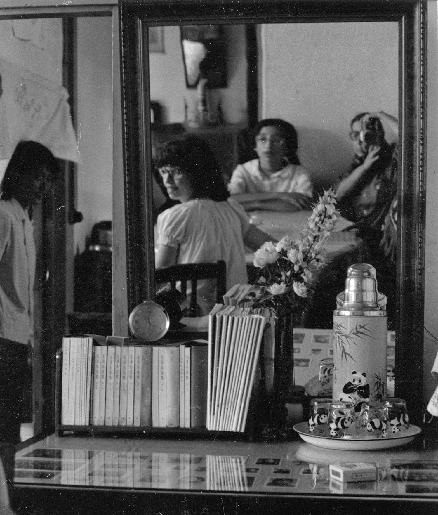 Elaine photographs a mirror