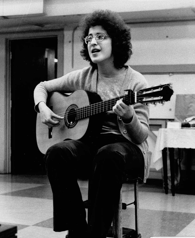 Judy plays the guitar