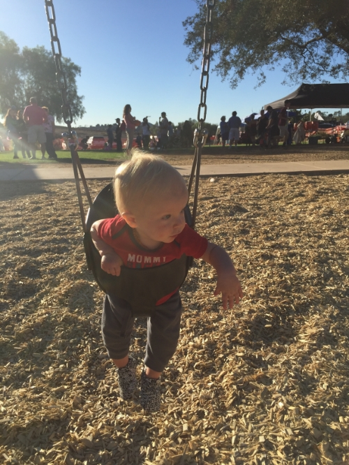Swinging on Halloween at a Trunk or Treat, not wearing a costume because it was another hot night in San Diego.