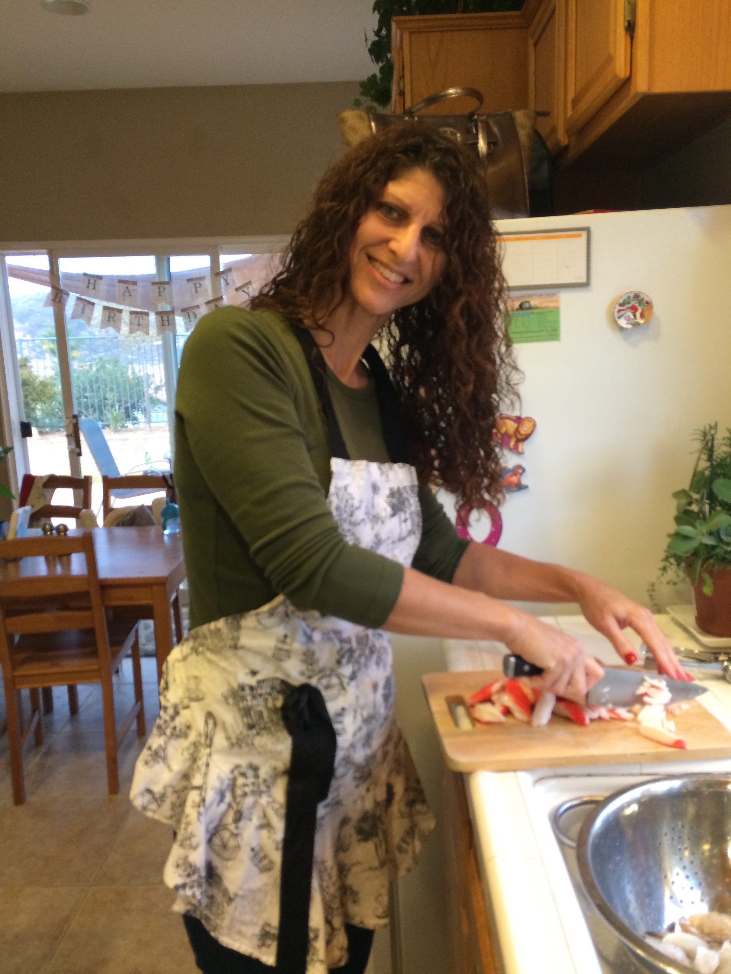 My mom making her famous stuffed shrimp on Thanksgiving Eve