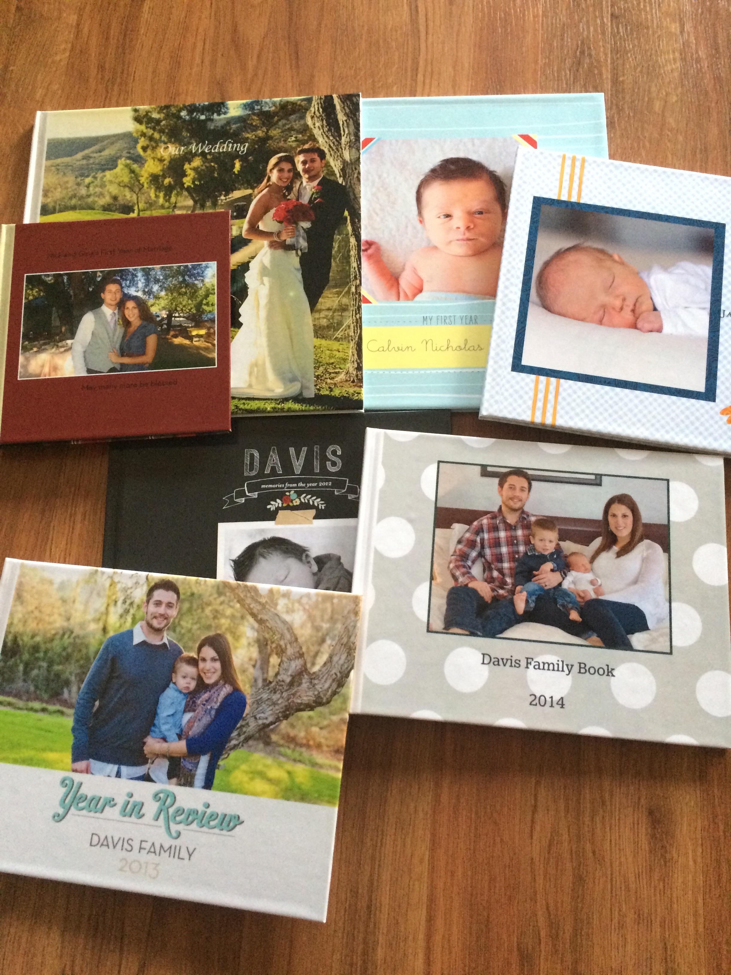 Some of our current books. I have our 2015 Family Book almost ready but am waiting for some good coupons before buying it.