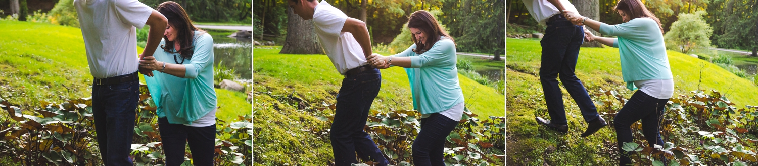 Dad helps pregnant mom up a hill during their maternity session in Indianapolis.