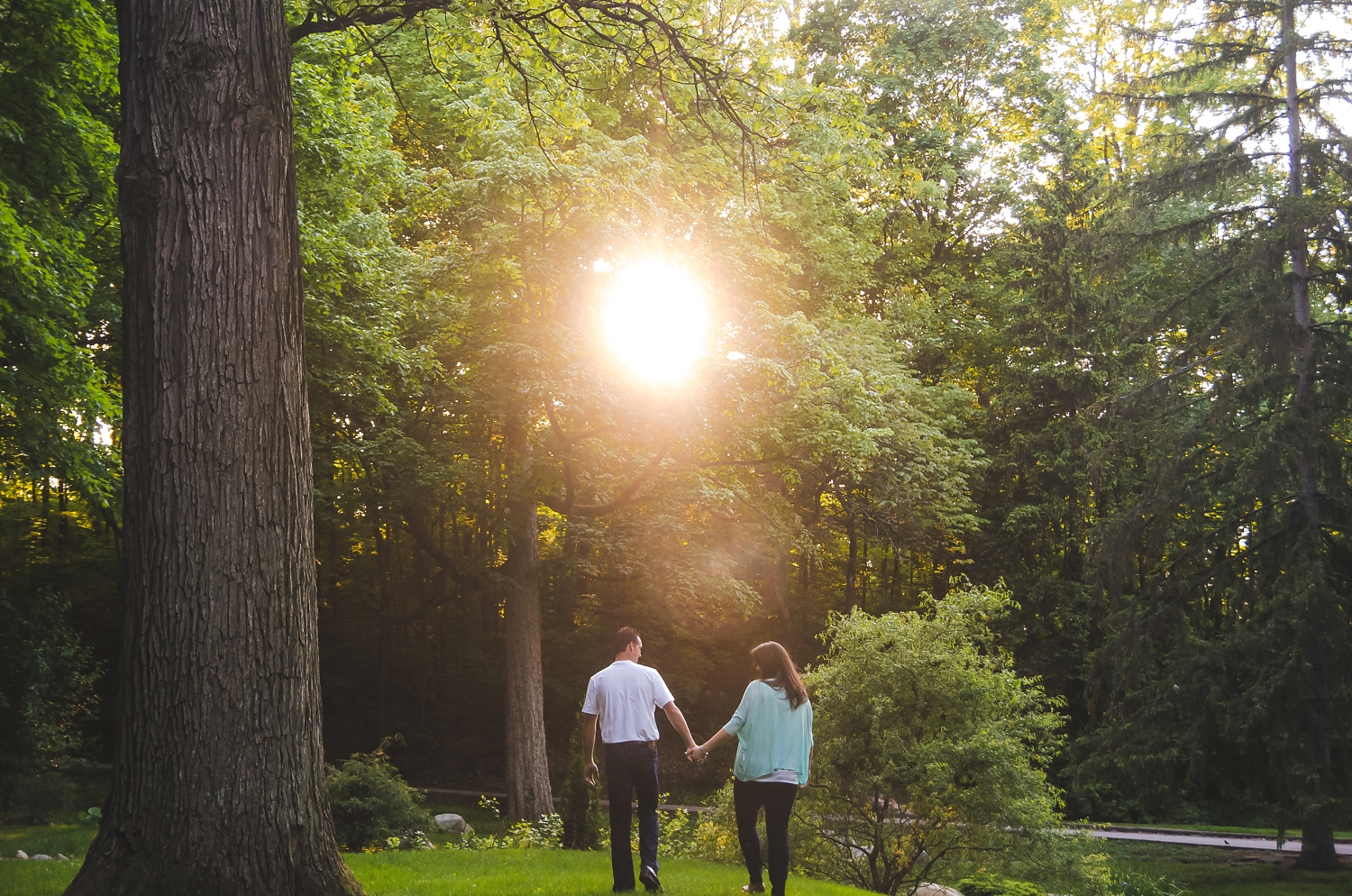 Couple walks towards the sunset during their Indianapolis photoshoot in Holcomb Gardens