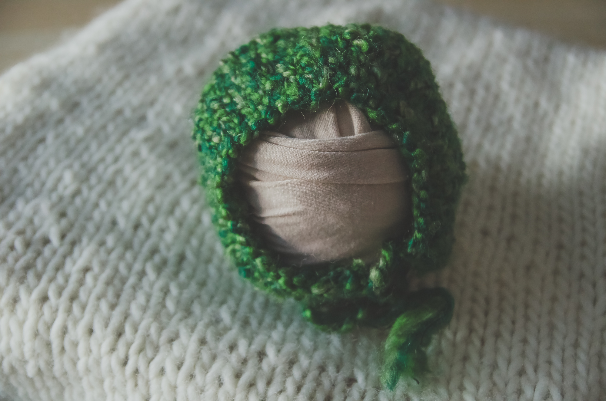 green knit bonnet for newborn photography