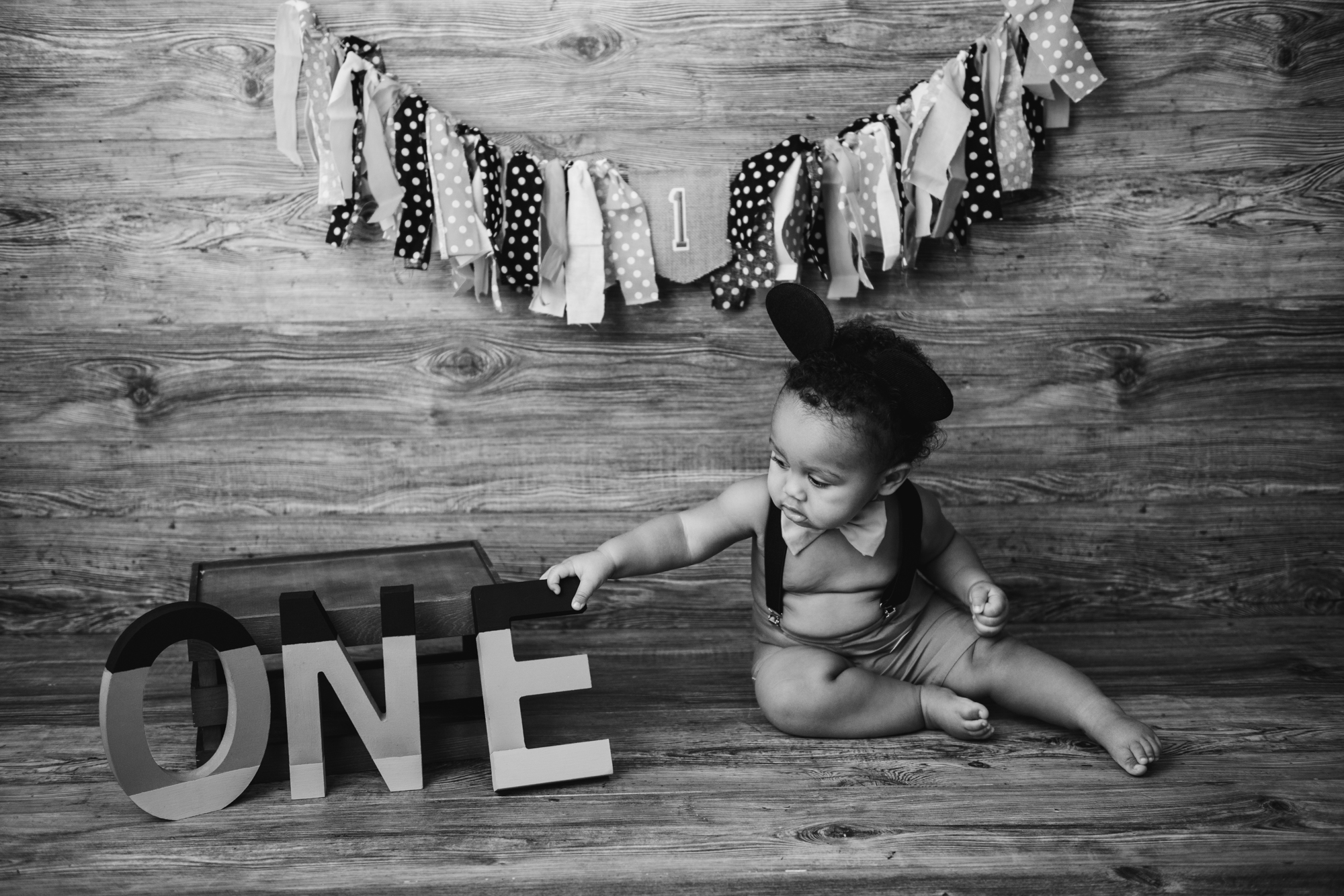 first birthday pictures on wooden stage