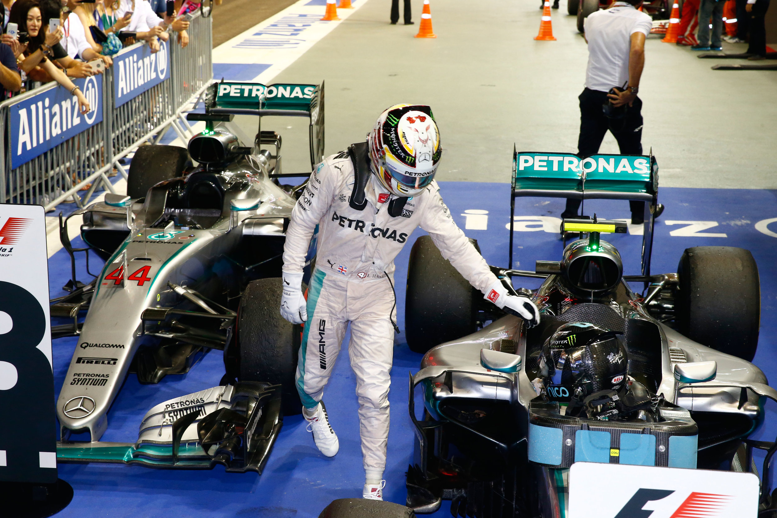 Hamilton congratulates Rosberg, or possibly tries to flick his ear. (Pic: Mercedes)