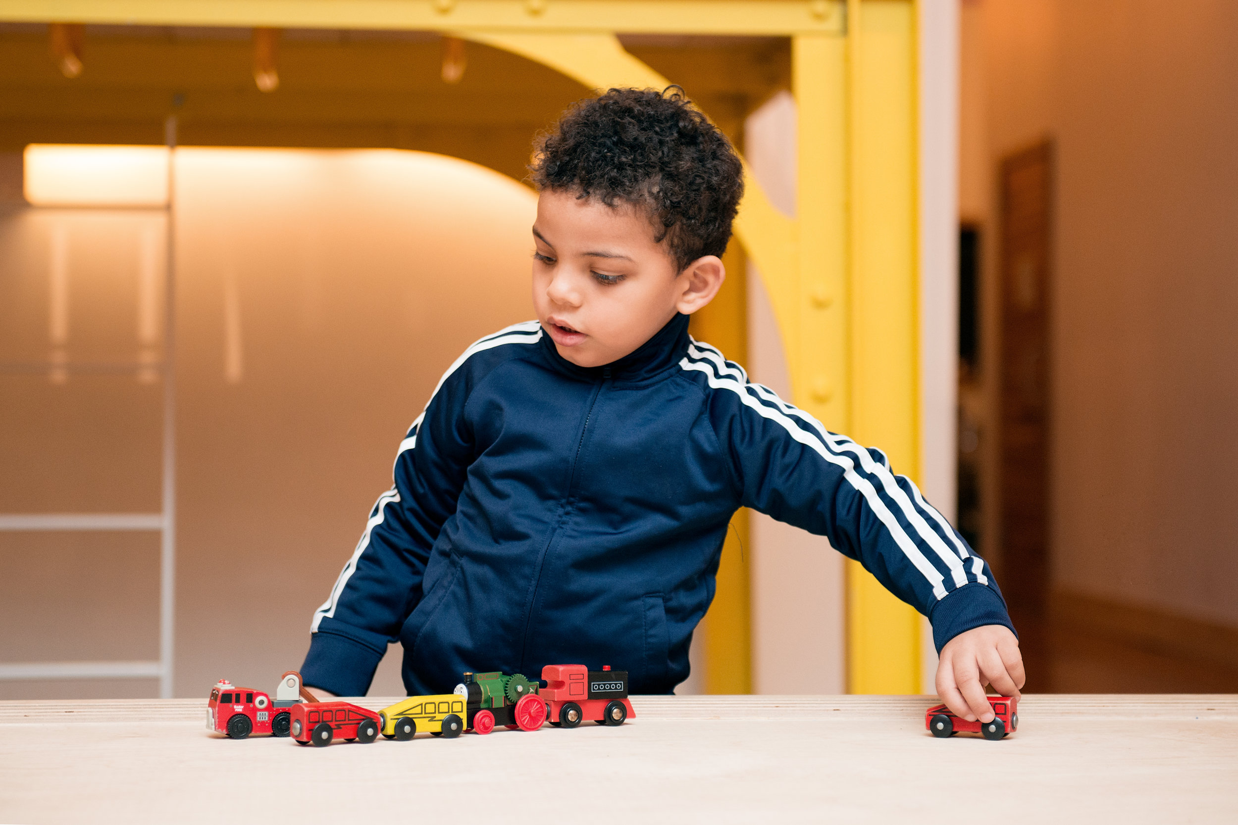Boy and train toys