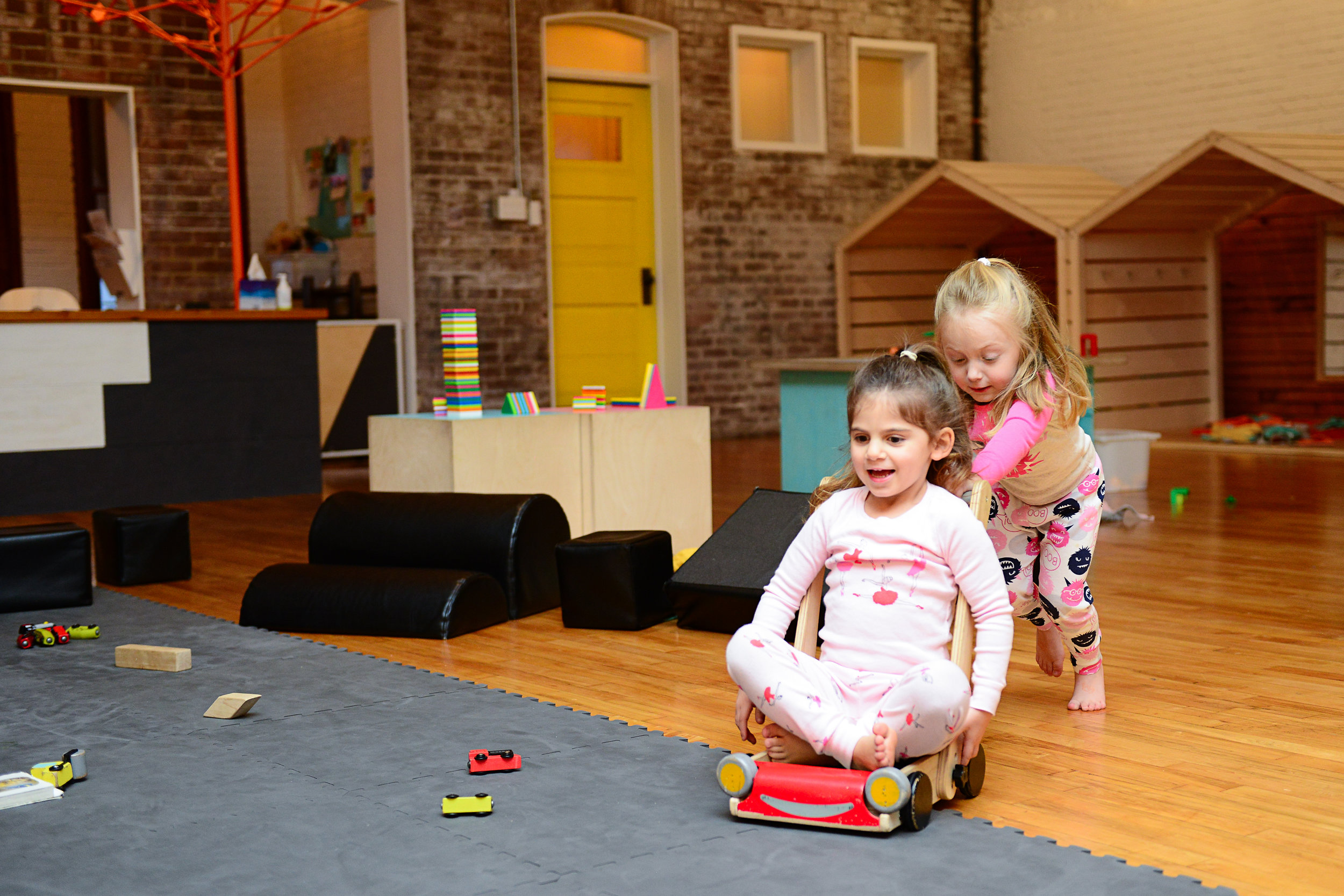 Girls playing in playspace